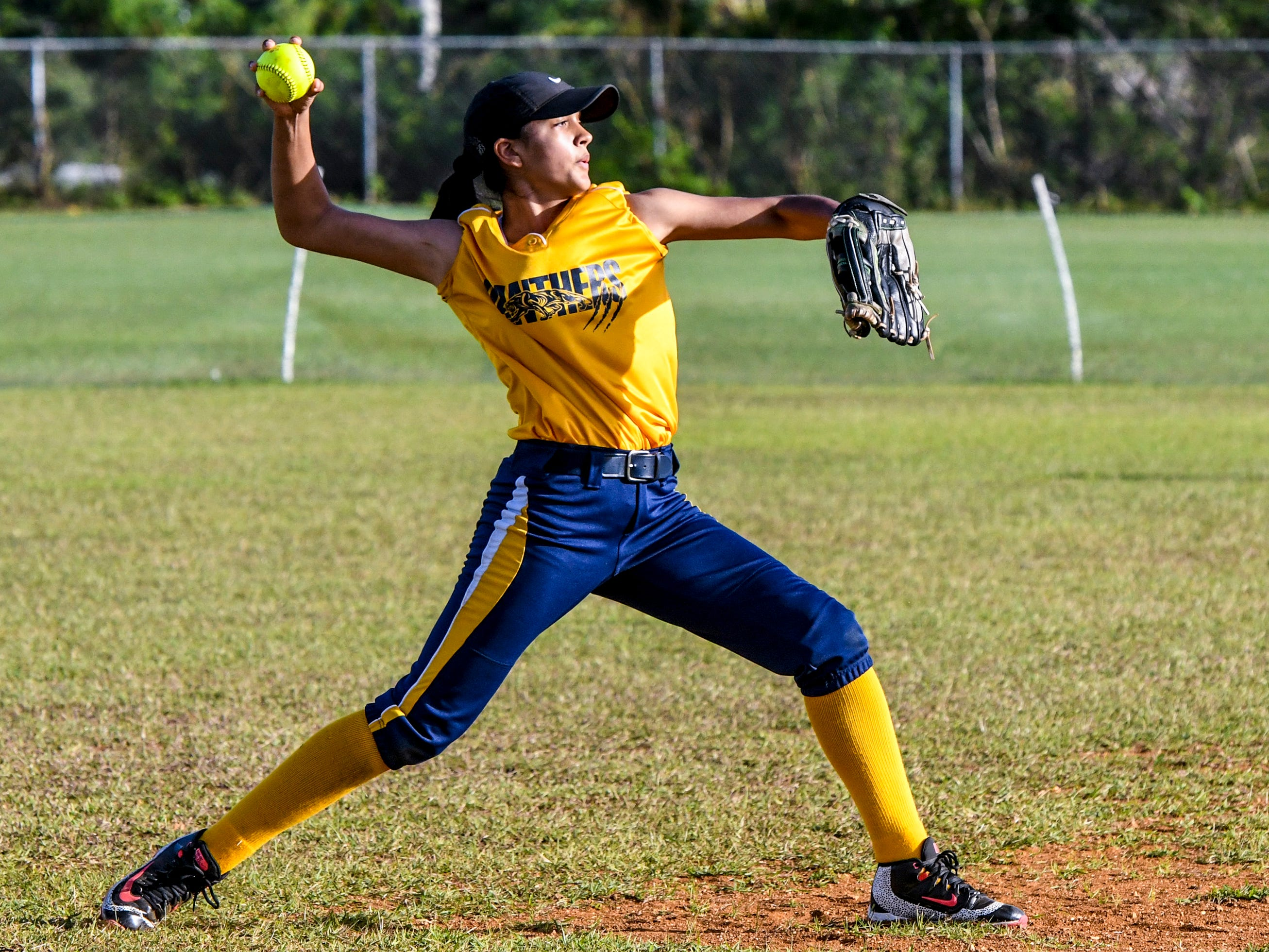 Guam High Panthers' Gabriella Rodriguez prepare to send a throw to first base during an IIAAG girls softball matchup with the John F. Kennedy Islanders at the JFK High School campus in Tamuning on Thursday, Feb. 7, 2019.