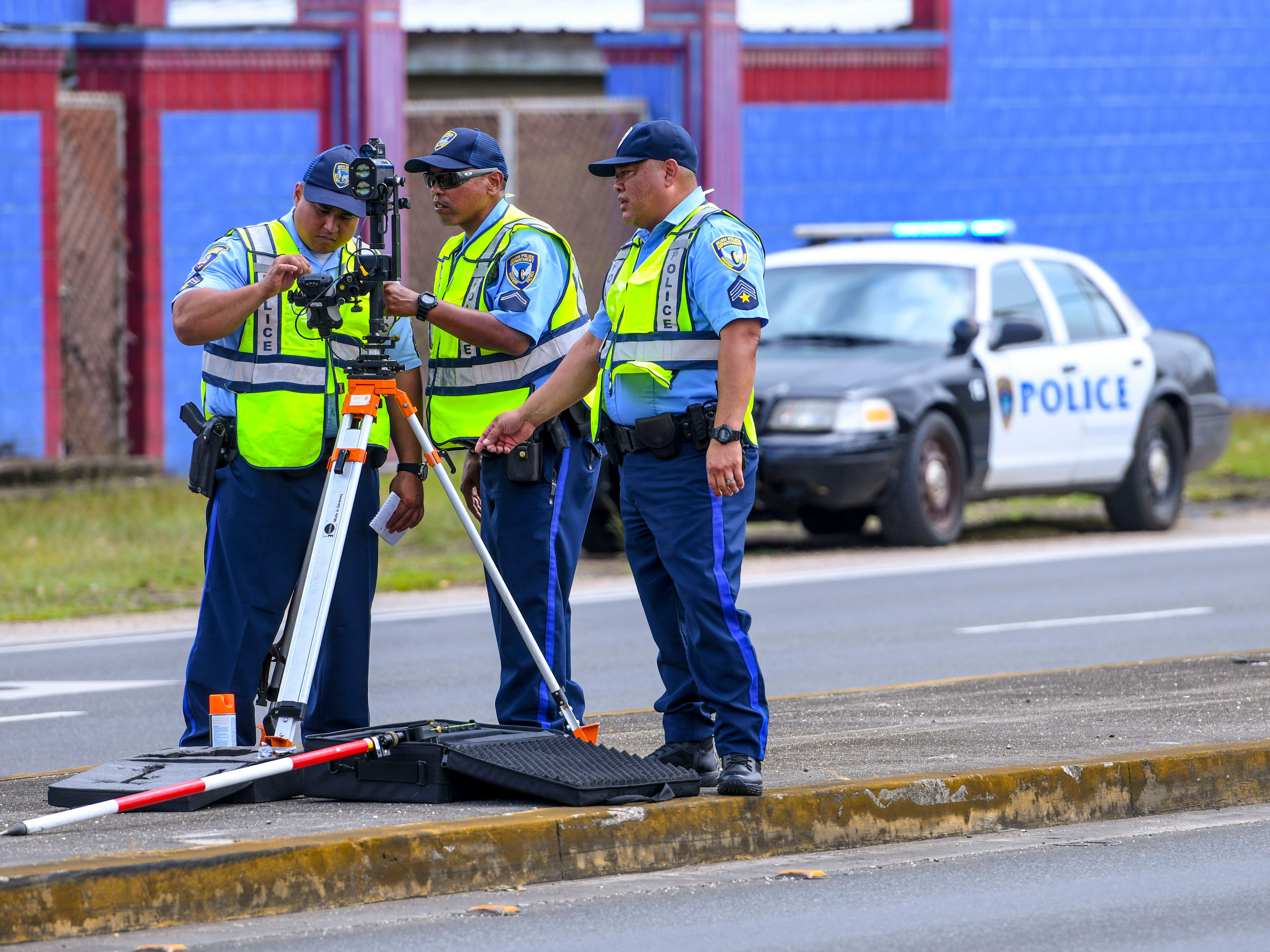 Officers with the Guam Police Department's Highway Patrol Division conduct an investigation on Feb. 7, 2019, of a two-car collision that may have resulted in the traffic fatality death of Deon Cruz, that happened on the evening of Feb. 4, near the Sunshine Plaza in Chalan Pago.