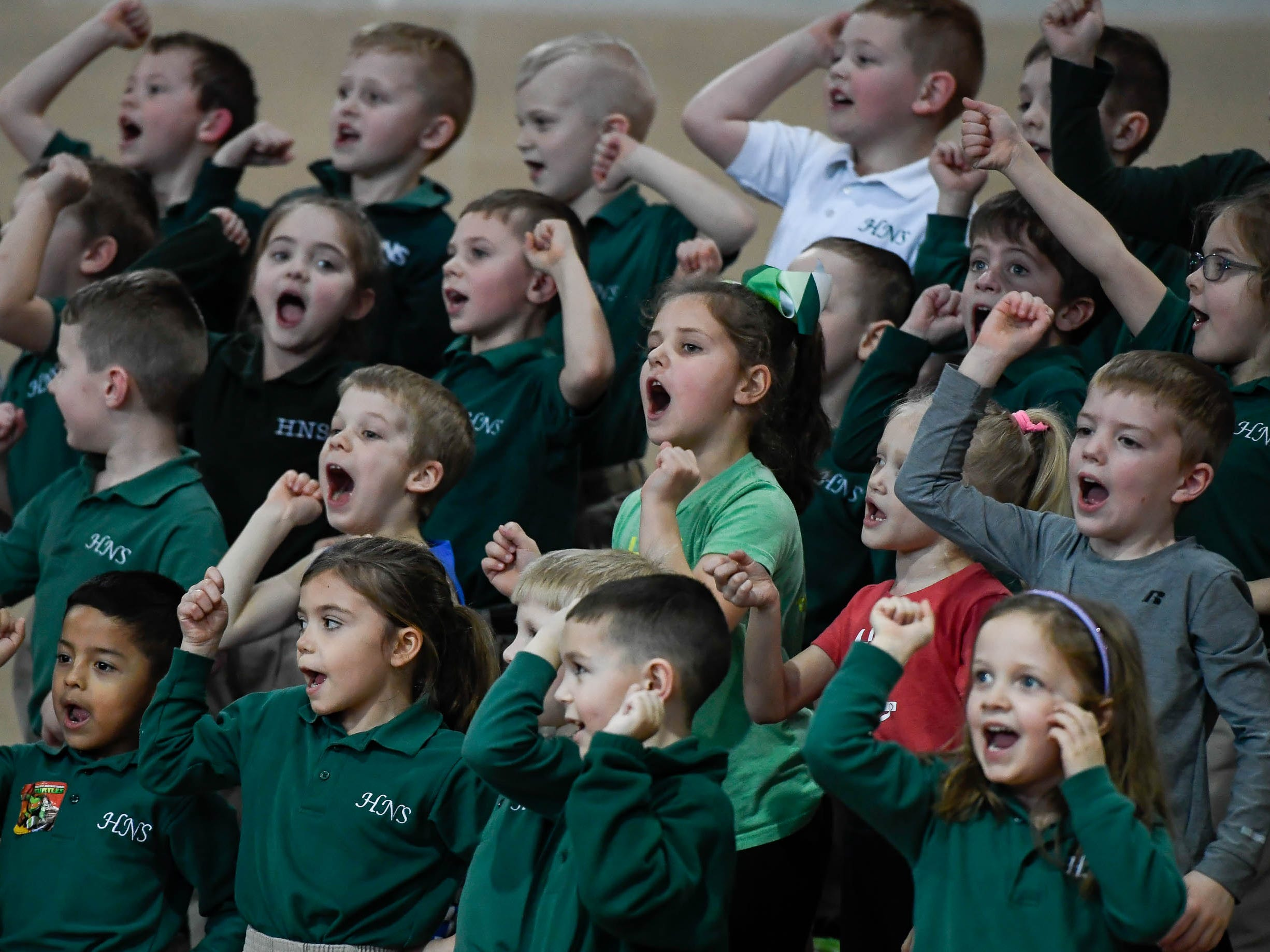 Holy Name kindergarten students sing he school's fight song during the Catholic Schools Week Talent Show at Henderson's Holy Name School Wednesday, February 6, 2019.