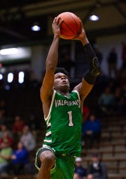 Valparaiso senior Brandon Newman (1) takes the ball up to the basket to score at the annual Hall of Fame Classic tournament,, Dec. 29, 2018.