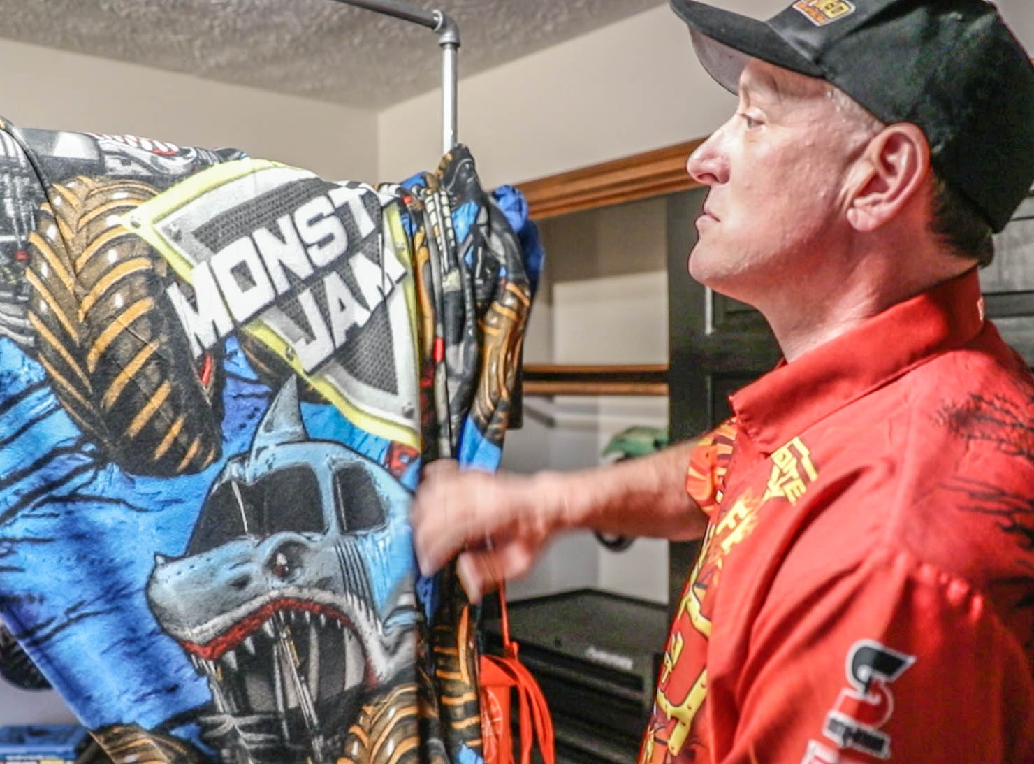 Maximum Destruction monster truck driver Tom Meents , shown here, shows James Egold, who just completed chemo therapy, his newly remodeled Monster Jam bedroom on Thursday, Feb. 7, 2019. The remodel was thanks to a team up by Monster Jam, Love Your Melon, and Home Depot.