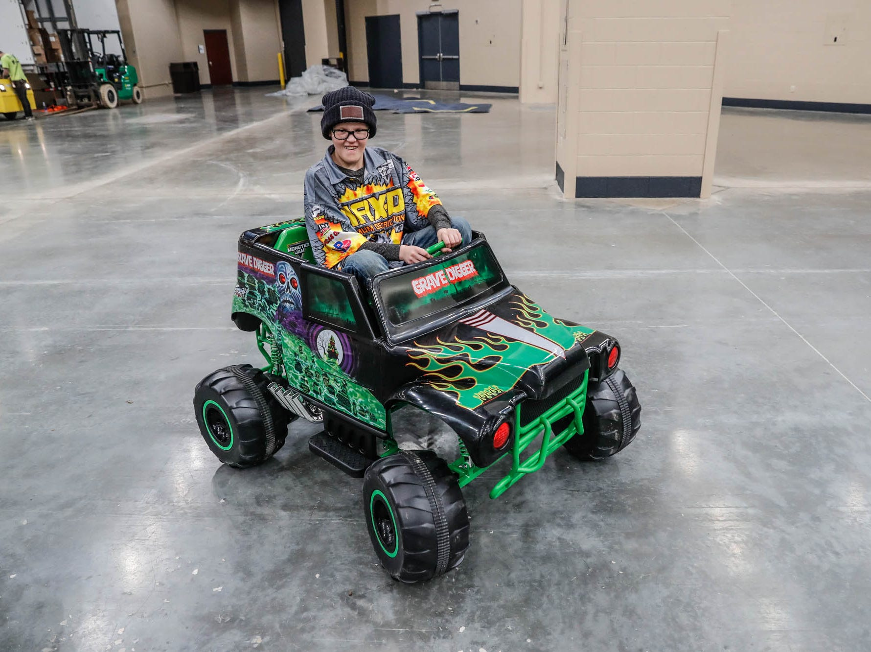 St. Barnabas Catholic School fourth grader, James Egold, who just completed chemo therapy, drives a mini Grave Digger Monster Truck behind the scenes of the Monster Jam at Lucas Oil Stadium on Thursday, Feb. 7, 2019. The visit was thanks to a team up by Monster Jam and Love Your Melon to remodel Egold's room at home while Egold met with Maximum Destruction monster truck driver Tom Meents.