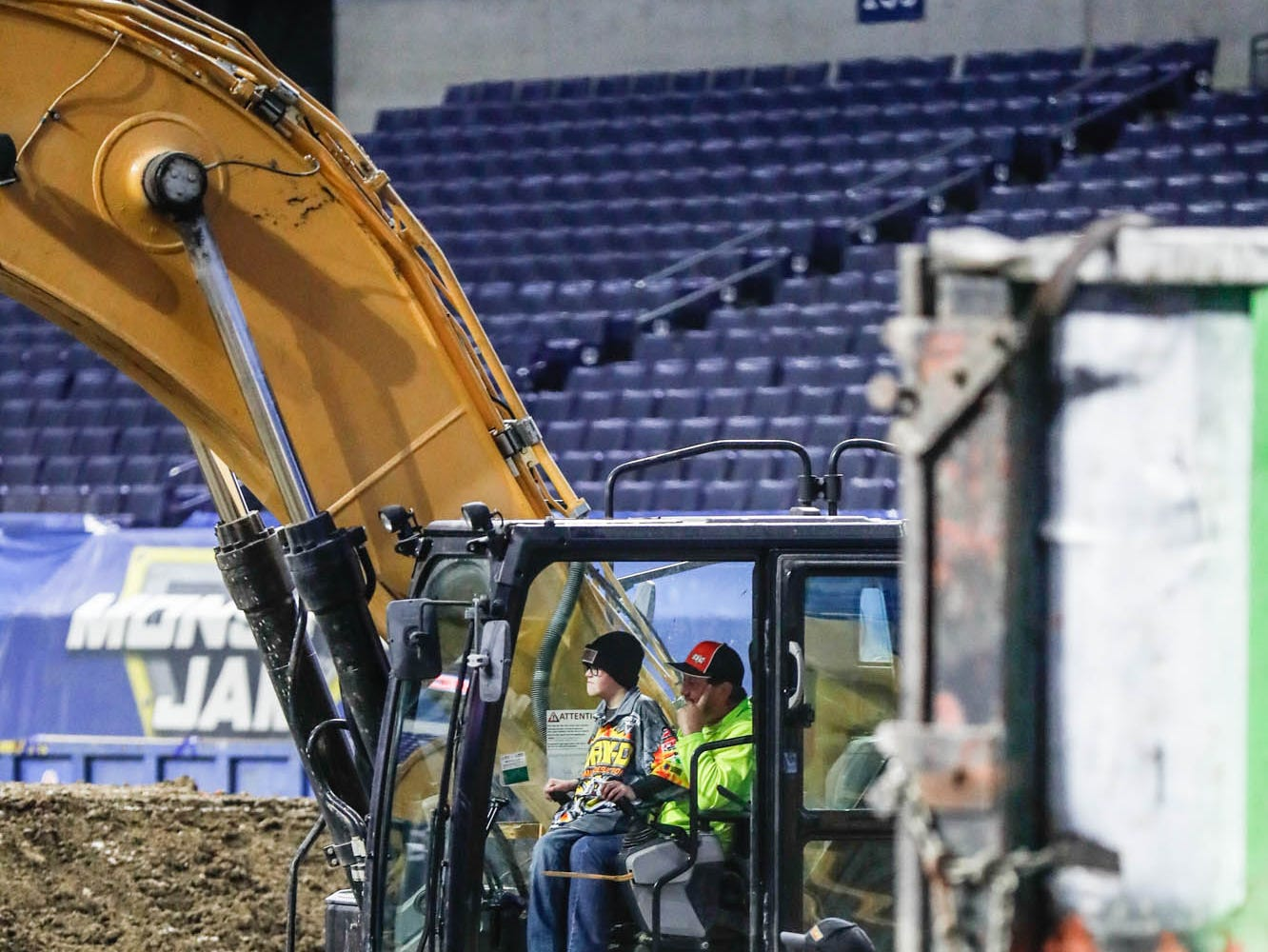 St. Barnabas Catholic School fourth grader, James Egold, who just completed chemo therapy, gets to dig a hole with an excavator and see how the dirt track is built for Monster Jam at Lucas Oil Stadium on Thursday, Feb. 7, 2019. The visit was thanks to a team up by Monster Jam and Love Your Melon to remodel Egold's room at home while Egold met with Maximum Destruction monster truck driver Tom Meents.