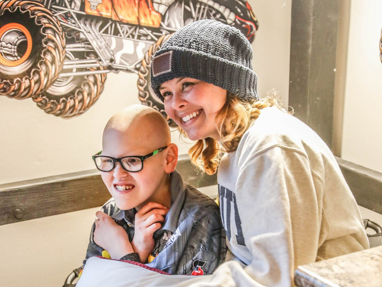 Volunteer Megan OÕDonnell, crew president for the Purdue Love Your Mellon group, poses for a photo with James Egold, who just completed chemo therapy, in his newly remodeled Monster Jam themed bedroom on Thursday, Feb. 7, 2019. The remodel was thanks to a team up by Monster Jam, Love Your Melon, and Home Depot.