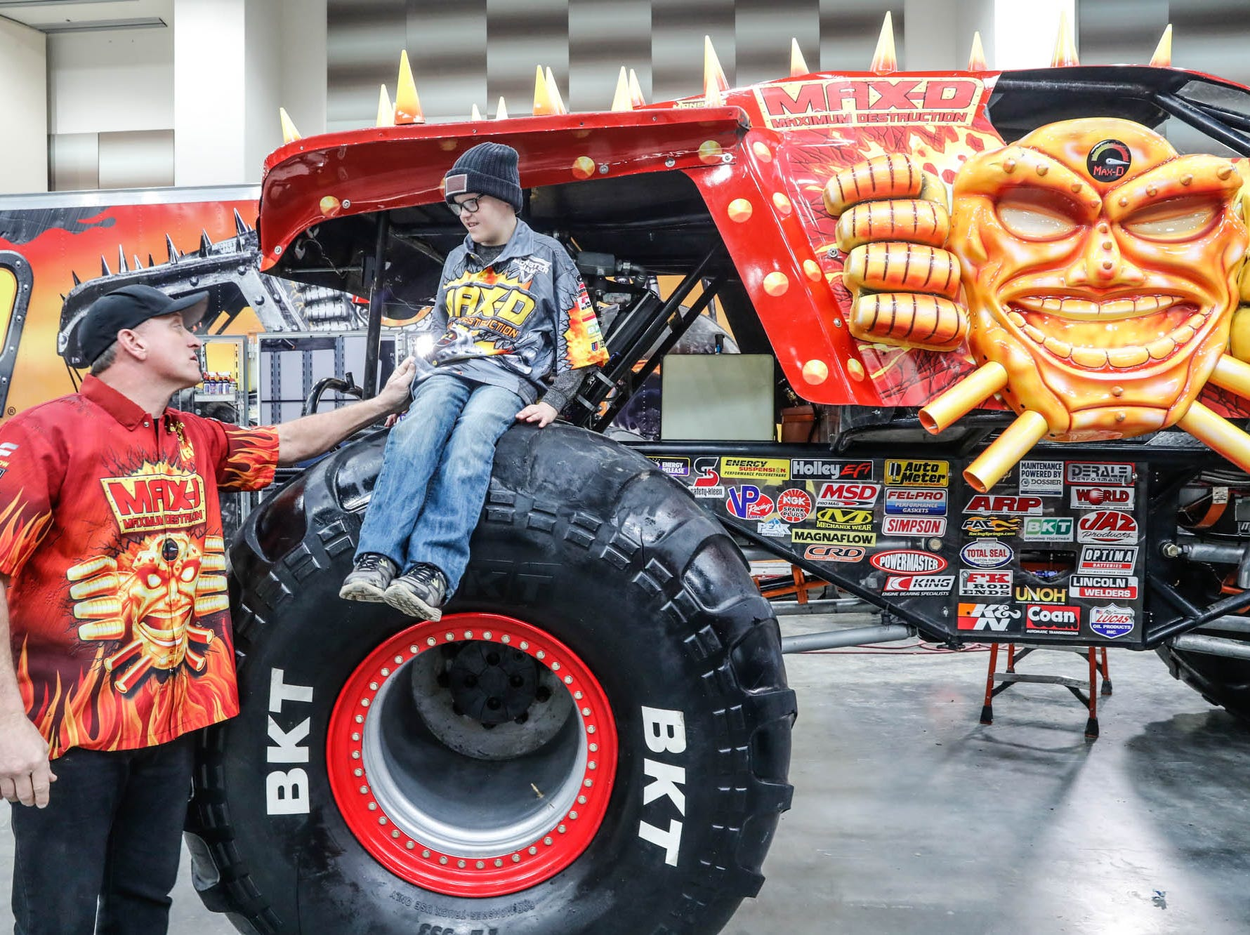 St. Barnabas Catholic School fourth grader, James Egold, who just completed chemo therapy, meets Maximum Destruction monster truck driver Tom Meents, behind the scenes of the Monster Jam at Lucas Oil Stadium on Thursday, Feb. 7, 2019. The visit was thanks to a team up by Monster Jam and Love Your Melon to remodel Egold's room at home while Egold met with Maximum Destruction monster truck driver Tom Meents.