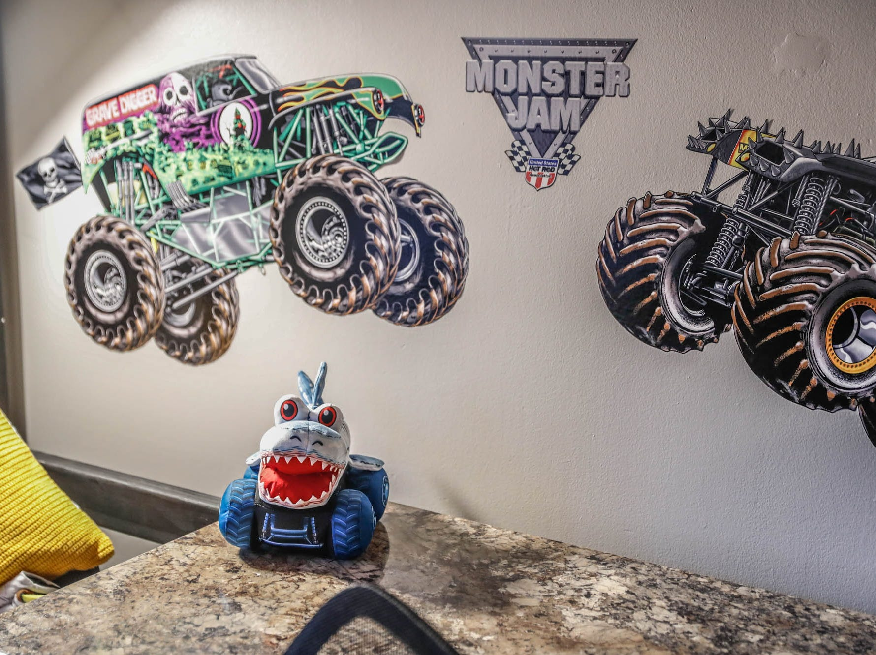 Monster Jam Fat Heads cover the walks in the newly remodeled bedroom of St. Barnabas Catholic School fourth grader, James Egold, who just completed chemo therapy, at Egold's south side home on Thursday, Feb. 7, 2019. The remodel was thanks to a team up by Monster Jam, Love Your Melon, and Home Depot.
