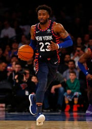 Feb 5, 2019; New York, NY, USA; New York Knicks guard Wesley Matthews (23) brings the ball up court against the Detroit Pistons during the second half at Madison Square Garden.
