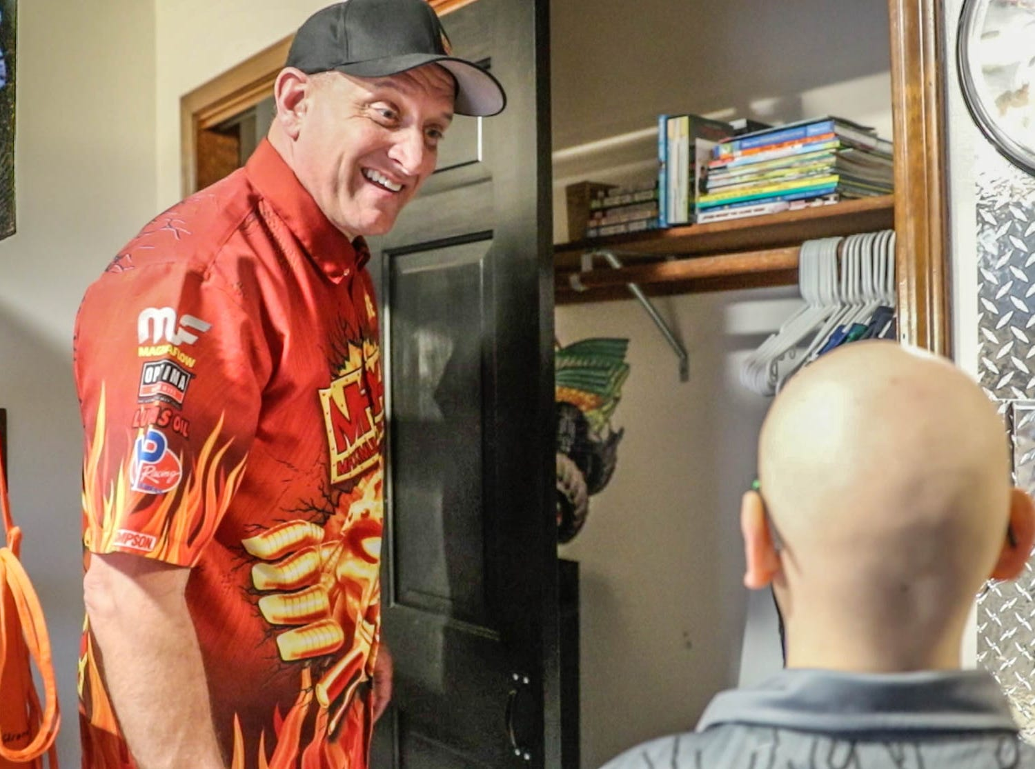 Maximum Destruction monster truck driver Tom Meents , left, shows James Egold, right, who just completed chemo therapy, his newly remodeled Monster Jam bedroom on Thursday, Feb. 7, 2019. The remodel was thanks to a team up by Monster Jam, Love Your Melon, and Home Depot.