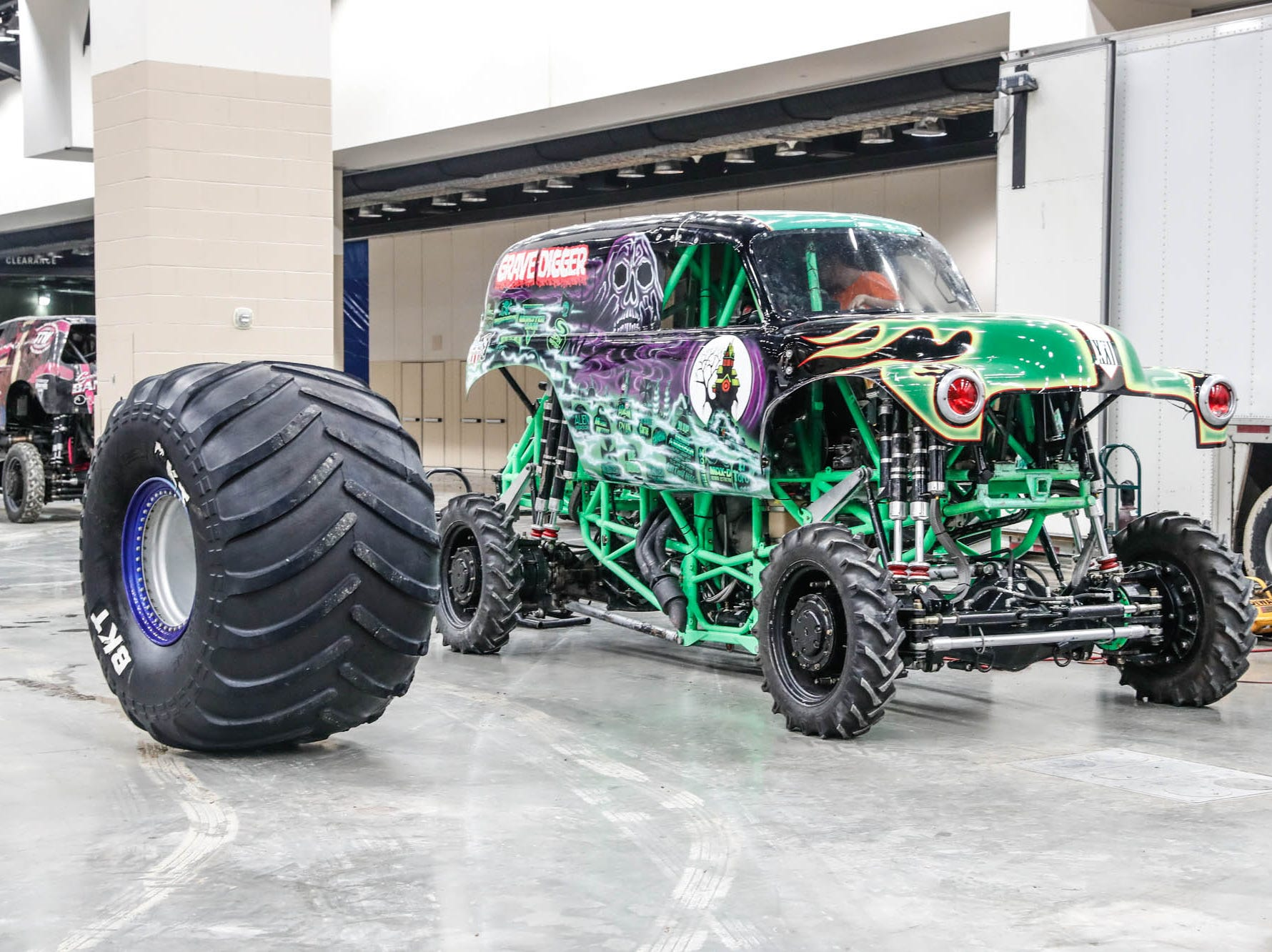 Grave Digger is unloaded from a truck with it's transport tires on behind the scenes of Monster Jam at Lucas Oil Stadium on Thursday, Feb. 7, 2019.