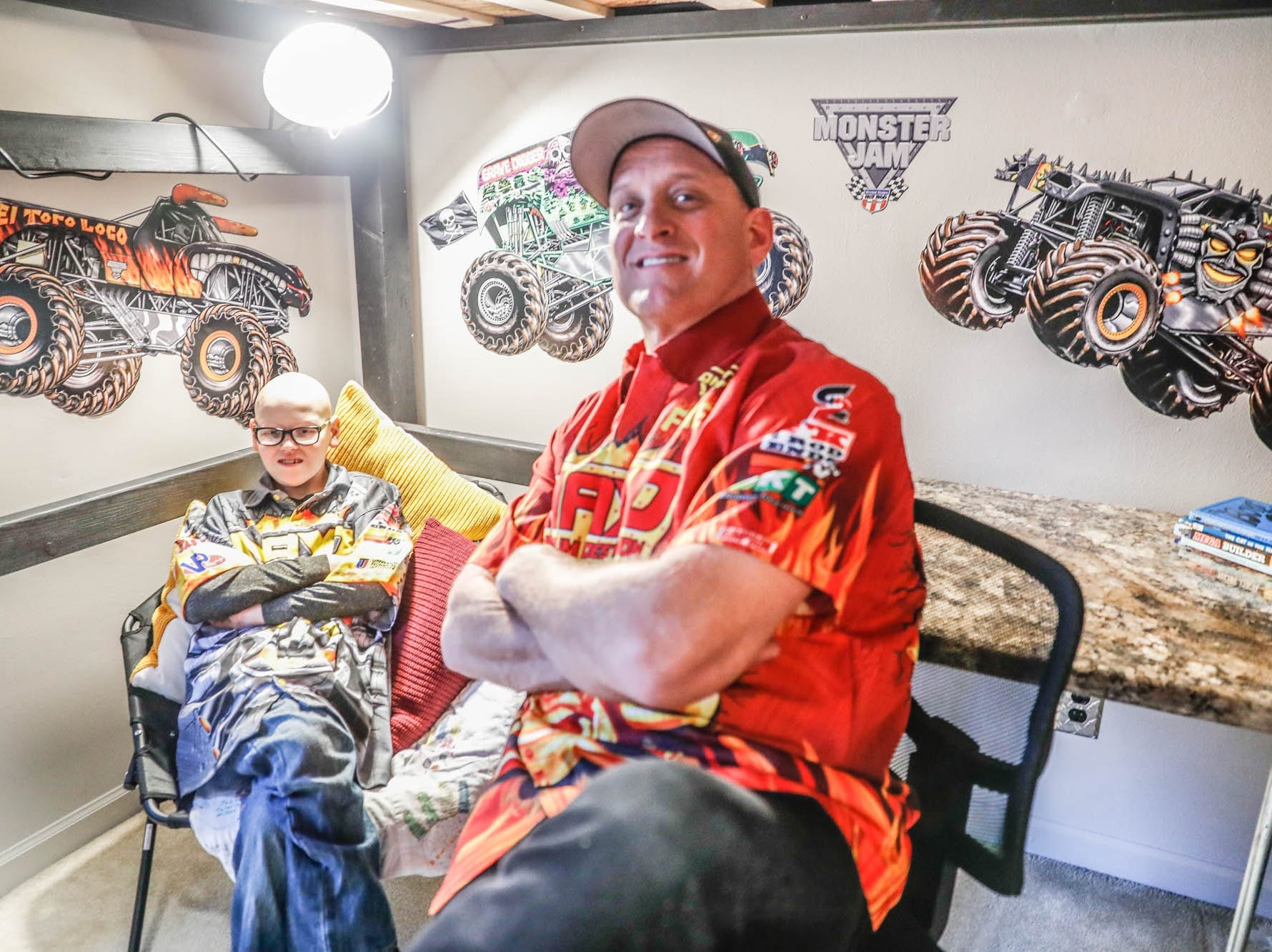 St. Barnabas Catholic School fourth grader, James Egold, who just completed chemo therapy, gets to see his newly decorated room with Maximum Destruction monster truck driver Tom Meents, at Egold's south side home on Thursday, Feb. 7, 2019. The visit was thanks to a team up by Monster Jam and Love Your Melon to remodel Egold's room at home while Egold met with Maximum Destruction monster truck driver Tom Meents.