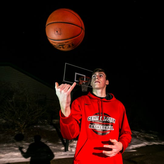 Central City junior Nick Reid poses for a photo with the game ball from the East Buchanan game where he scored 76 points, Wednesday, Feb. 6, 2019, in front of the basketball hoop he practices on at home in Central City, Iowa. Reid led the Wildcats to a 86-76, victory.