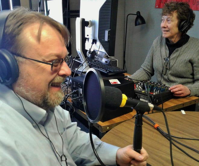 Craig Jarvie and Holly Hart are two key volunteer players in keeping the new KICI Radio (FM 105.3) on the air, working from this studio along South Dubuque Street in Iowa City.