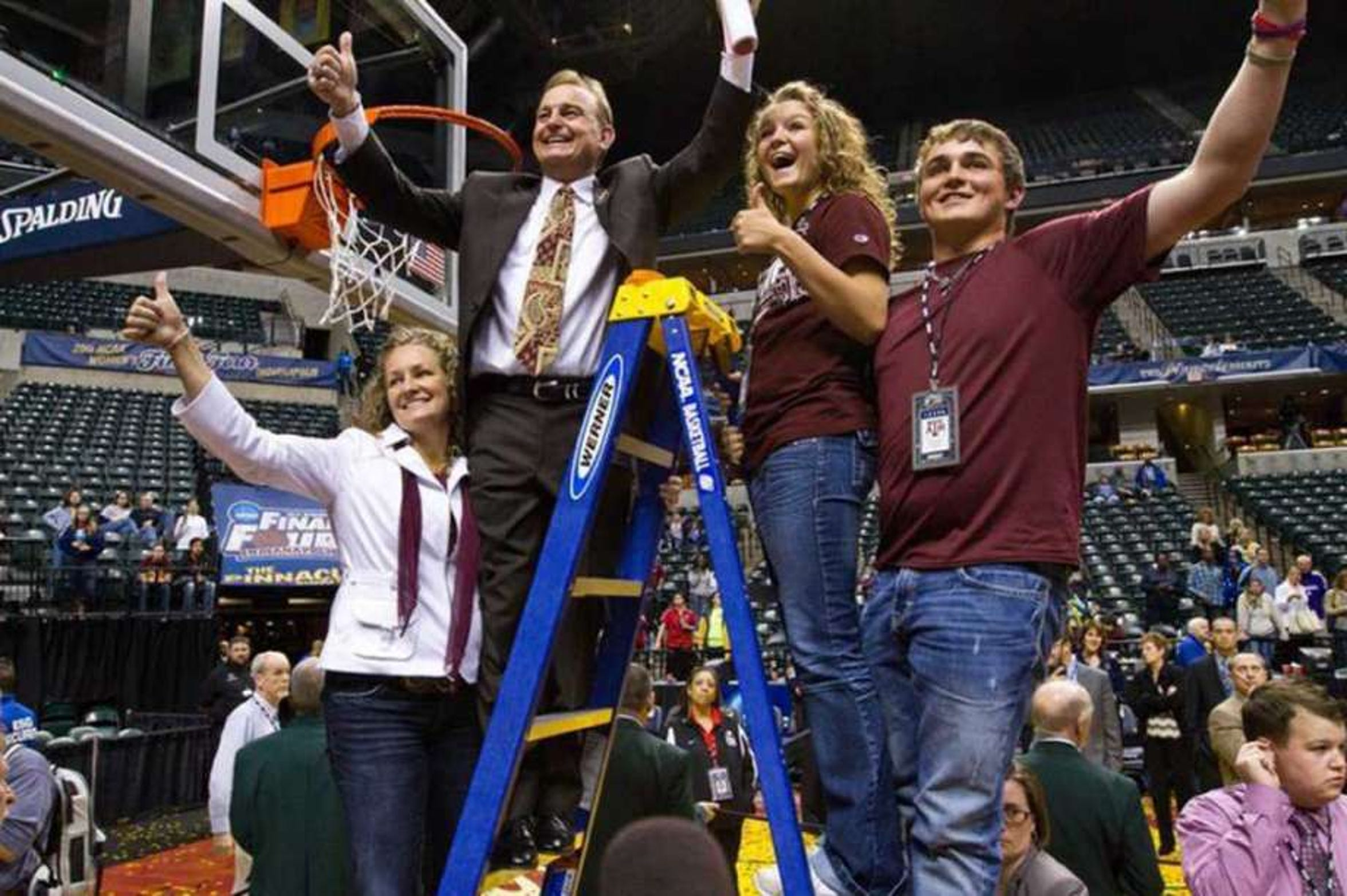 Vic Schaefer and his wife Holly (far left) and twin children Blair (middle right) and Logan (far right) celebrate Texas A&M's 2011 national championship. Schaefer was Gary Blair's associate head coach at A&M.