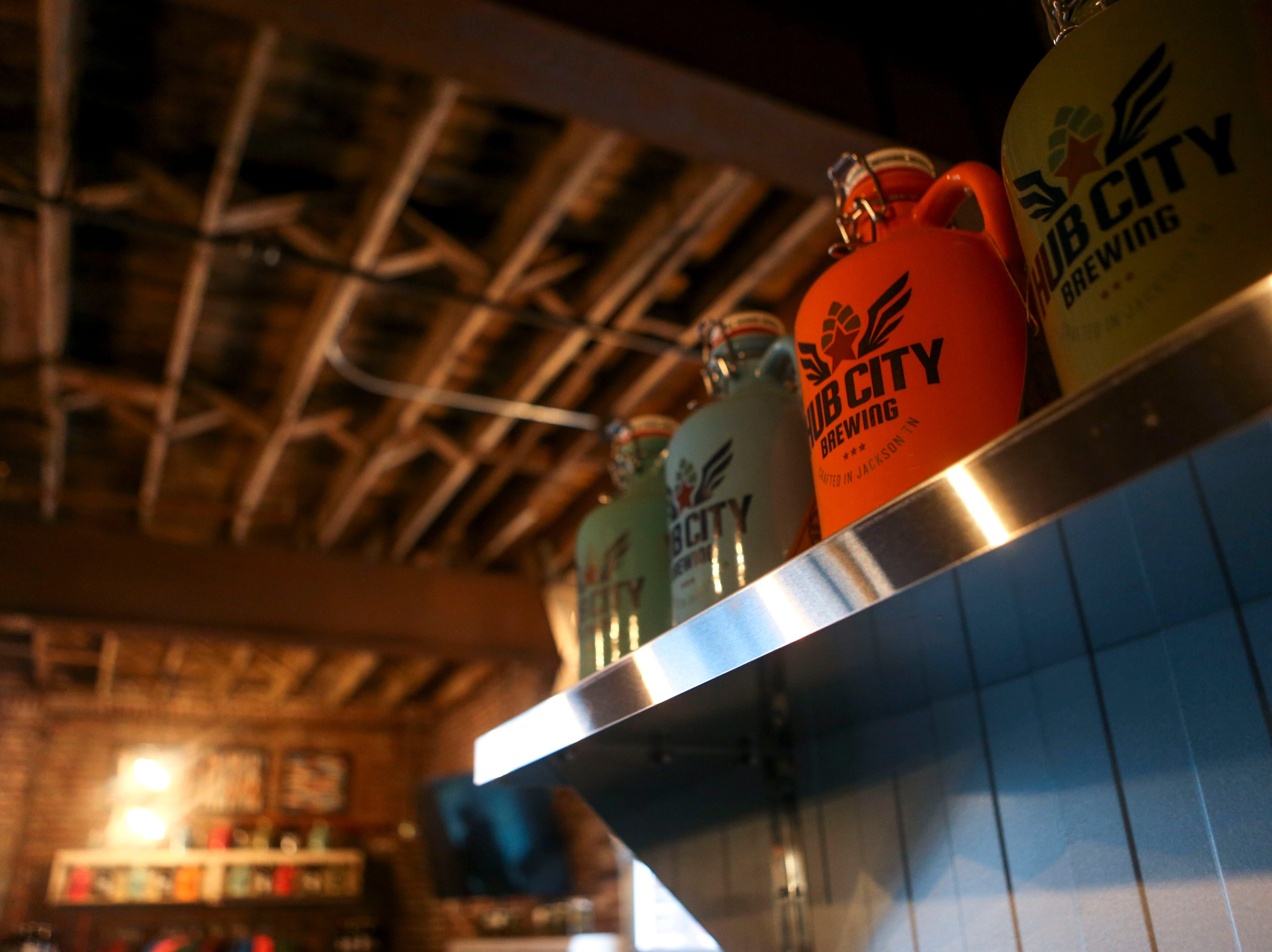 A growler with the brewery's logo can be seen atop a shelf at Hub City Brewing in Jackson, Tenn., on Wednesday, Feb. 6, 2019.