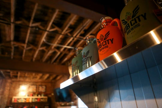 Growler sit atop a shelf at Hub City Brewing in Jackson on Feb. 6.