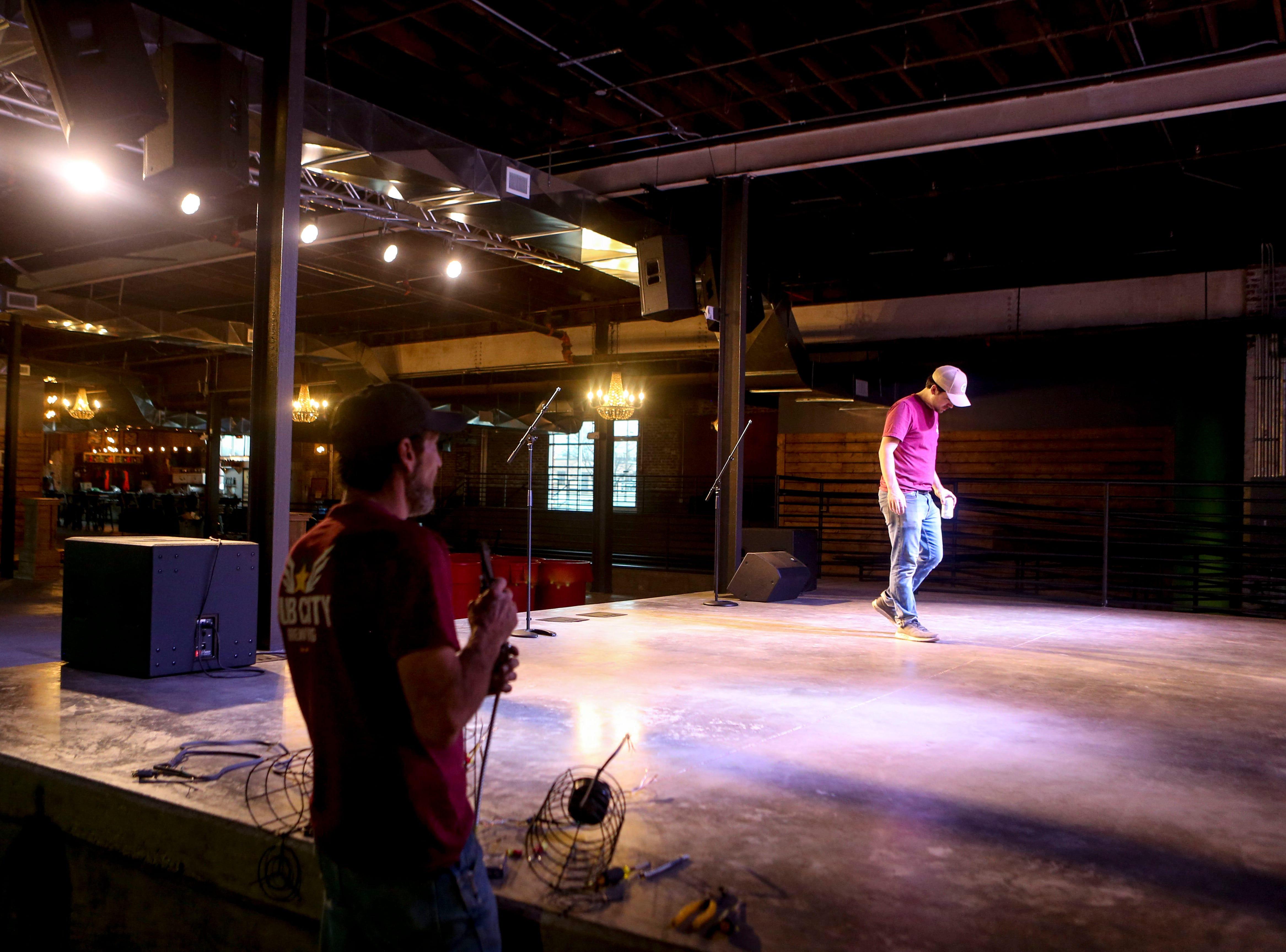 Lewis Silvers walks on the stage and examines the spread of spotlights at Hub City Brewing in Jackson, Tenn., on Wednesday, Feb. 6, 2019.