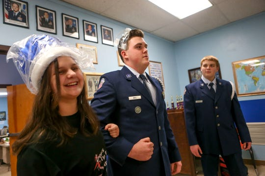 Gabrielle Willumat, 17, a junior, left, and Kaleb Bull, 17, a sophomore, mock how they will wear the crowns for the military ball during ROTC class at Lexington High School in Lexington, Tenn., on Wednesday, Feb. 6, 2019.