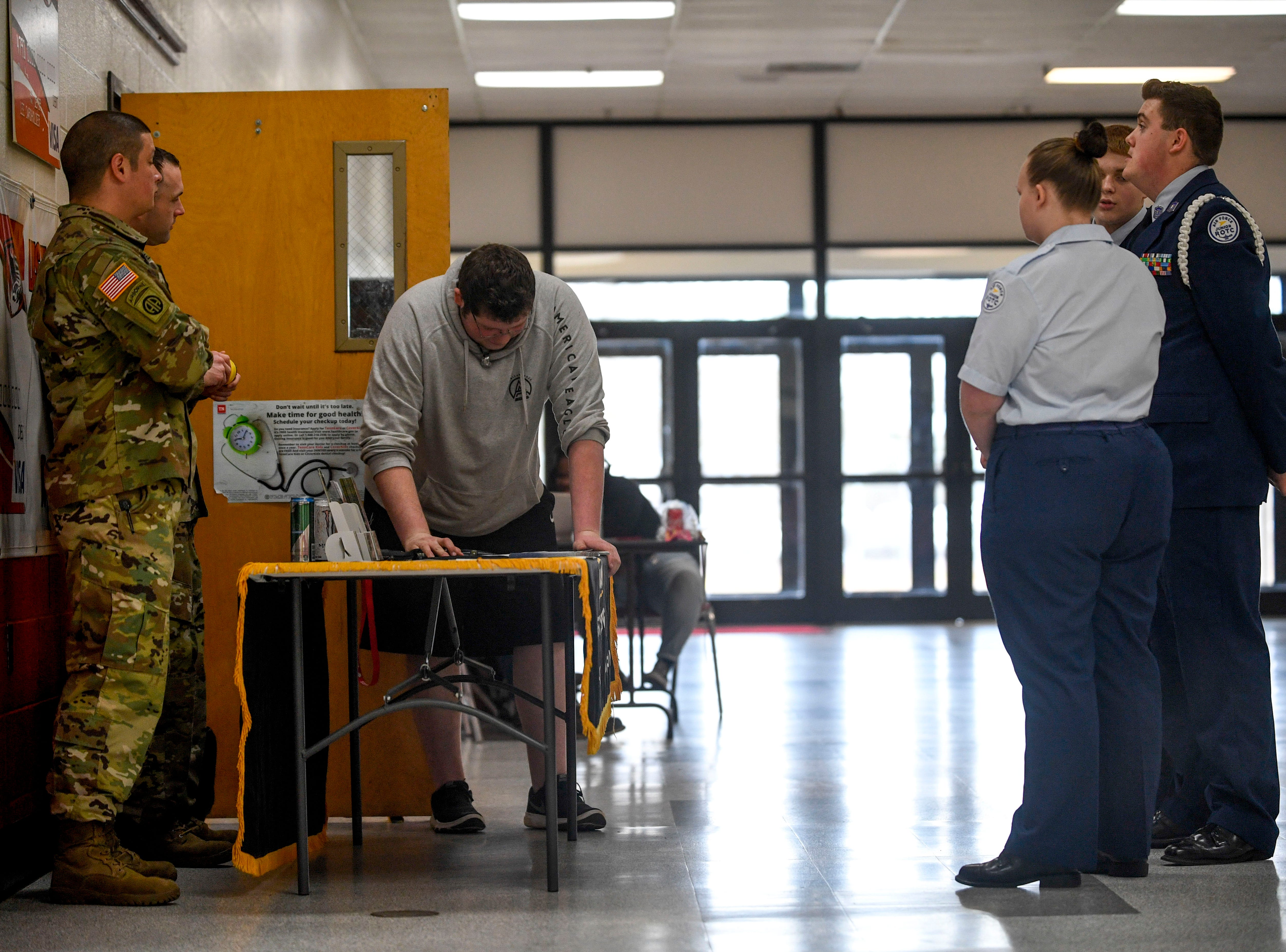 ROTC students speak with Army recruiters SSG Sheldon and SSG Moss during ROTC class at Lexington High School in Lexington, Tenn., on Wednesday, Feb. 6, 2019.