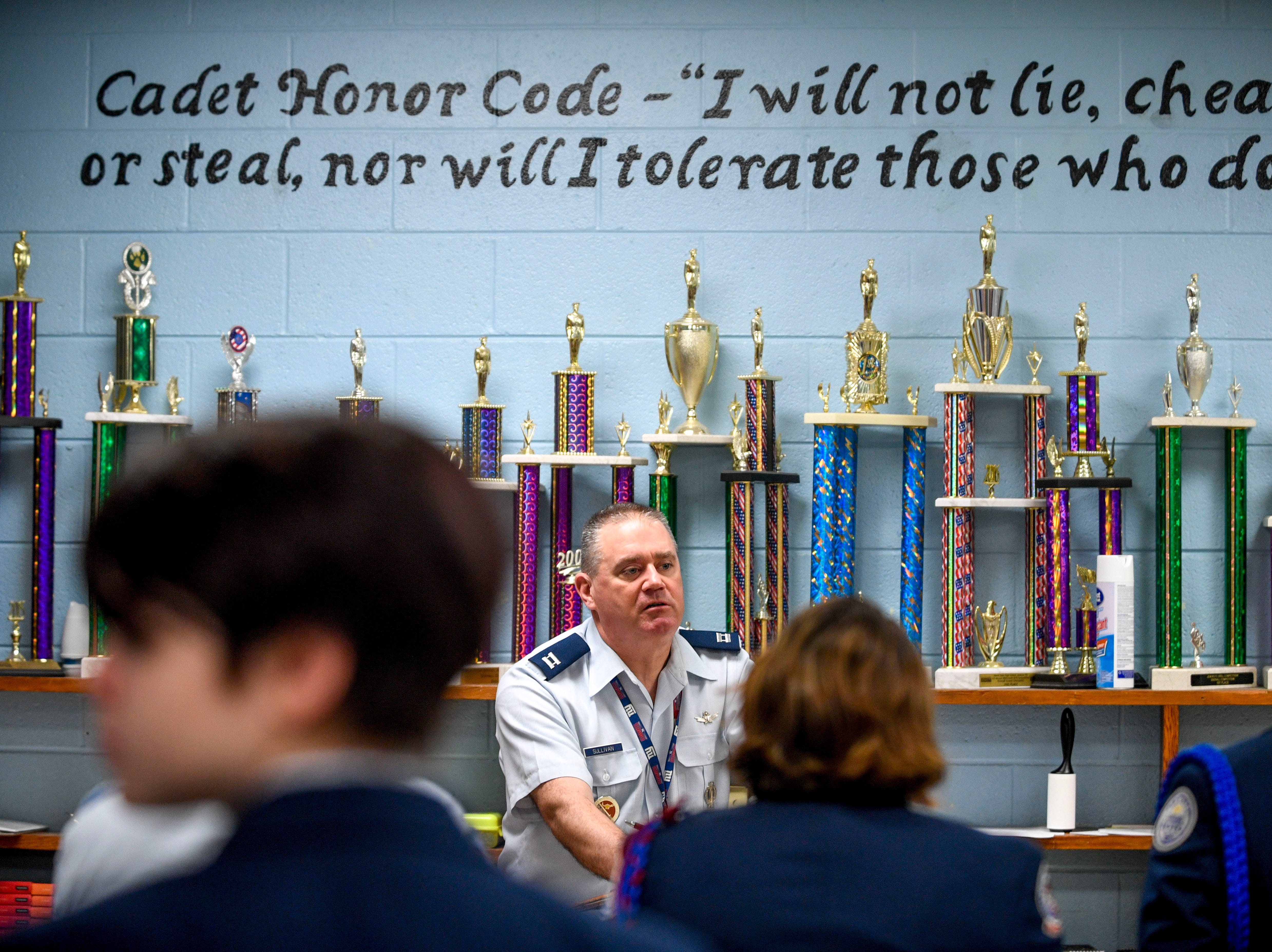 Captain Ken Sullivan speaks to students at the start of the period during ROTC class at Lexington High School in Lexington, Tenn., on Wednesday, Feb. 6, 2019.