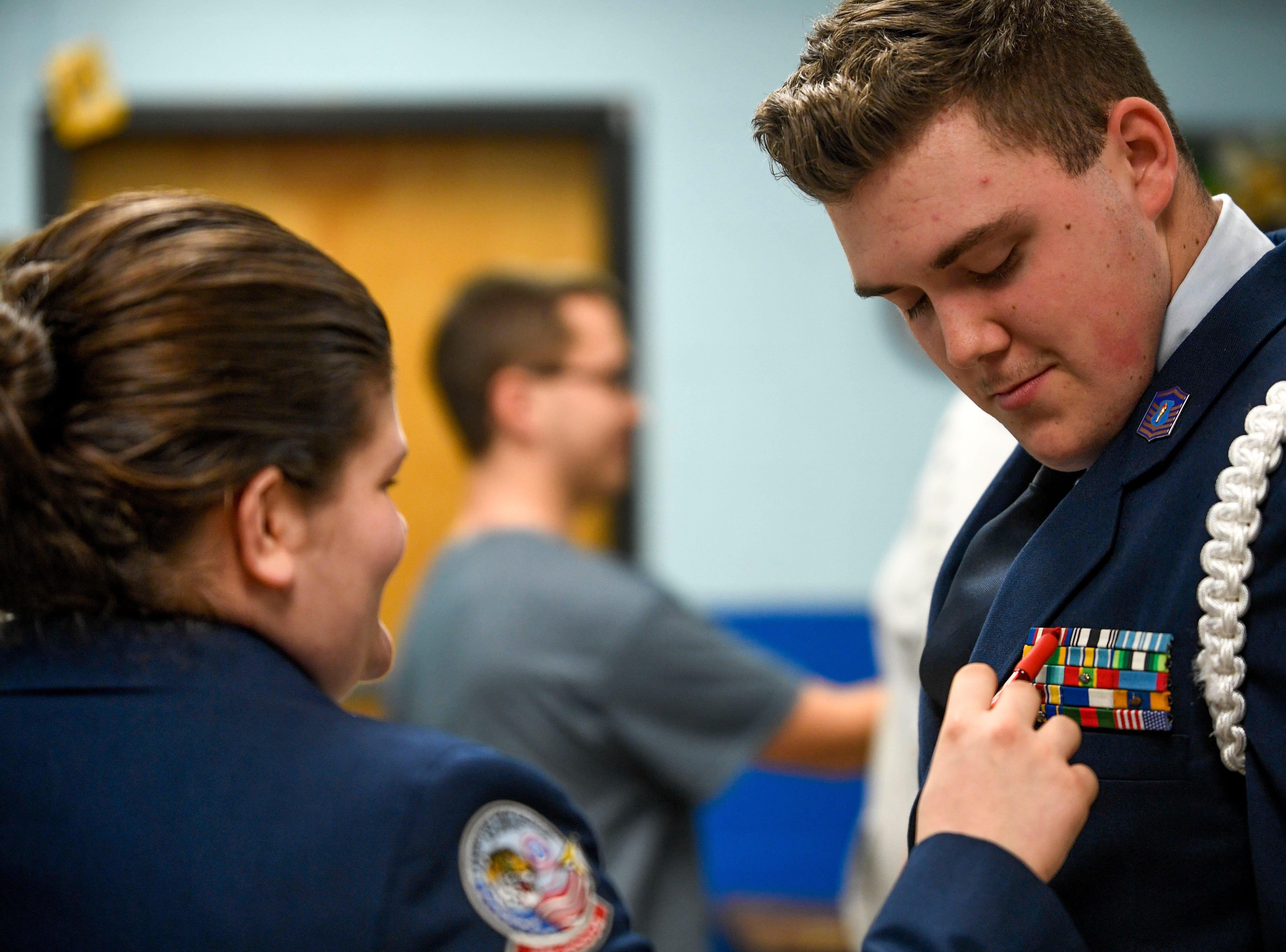 Kendalynn Henley, left, 16, a junior, performs a uniform inspection with Kaleb Bull, 17, a sophomore, right, during ROTC class at Lexington High School in Lexington, Tenn., on Wednesday, Feb. 6, 2019.
