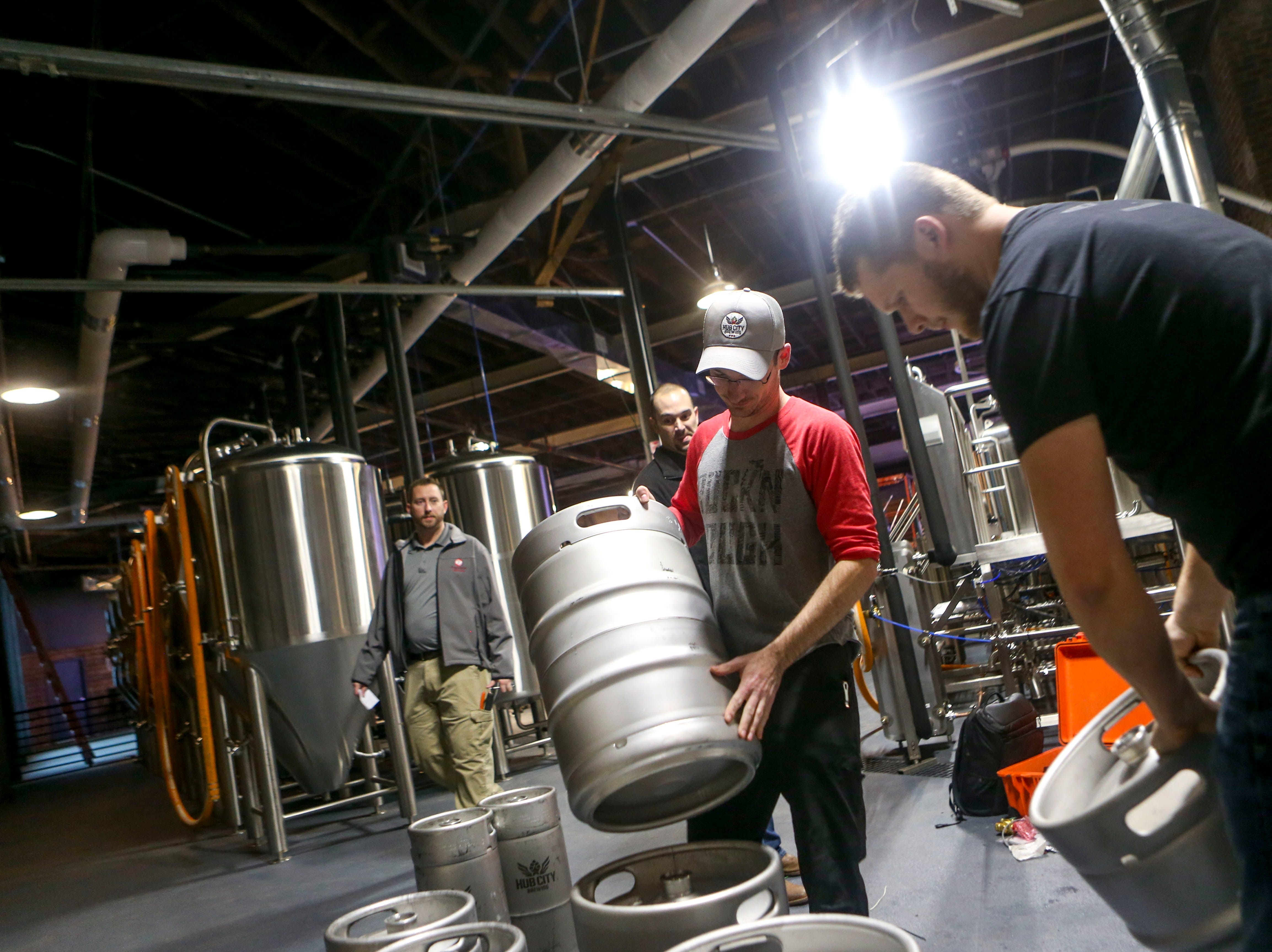 Michael Lorens, right, with American Beer Equipment, trains Hub City master brewer Cody Stooksberry, left, on preparing kegs at Hub City Brewing in Jackson, Tenn., on Wednesday, Feb. 6, 2019.
