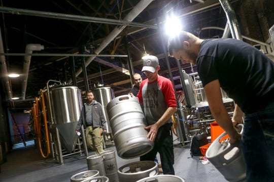 Michael Lorens, right, with American Beer Equipment, trains Hub City master brewer Cody Stooksberry on preparing kegs at Hub City Brewing in Jackson on Feb. 6.