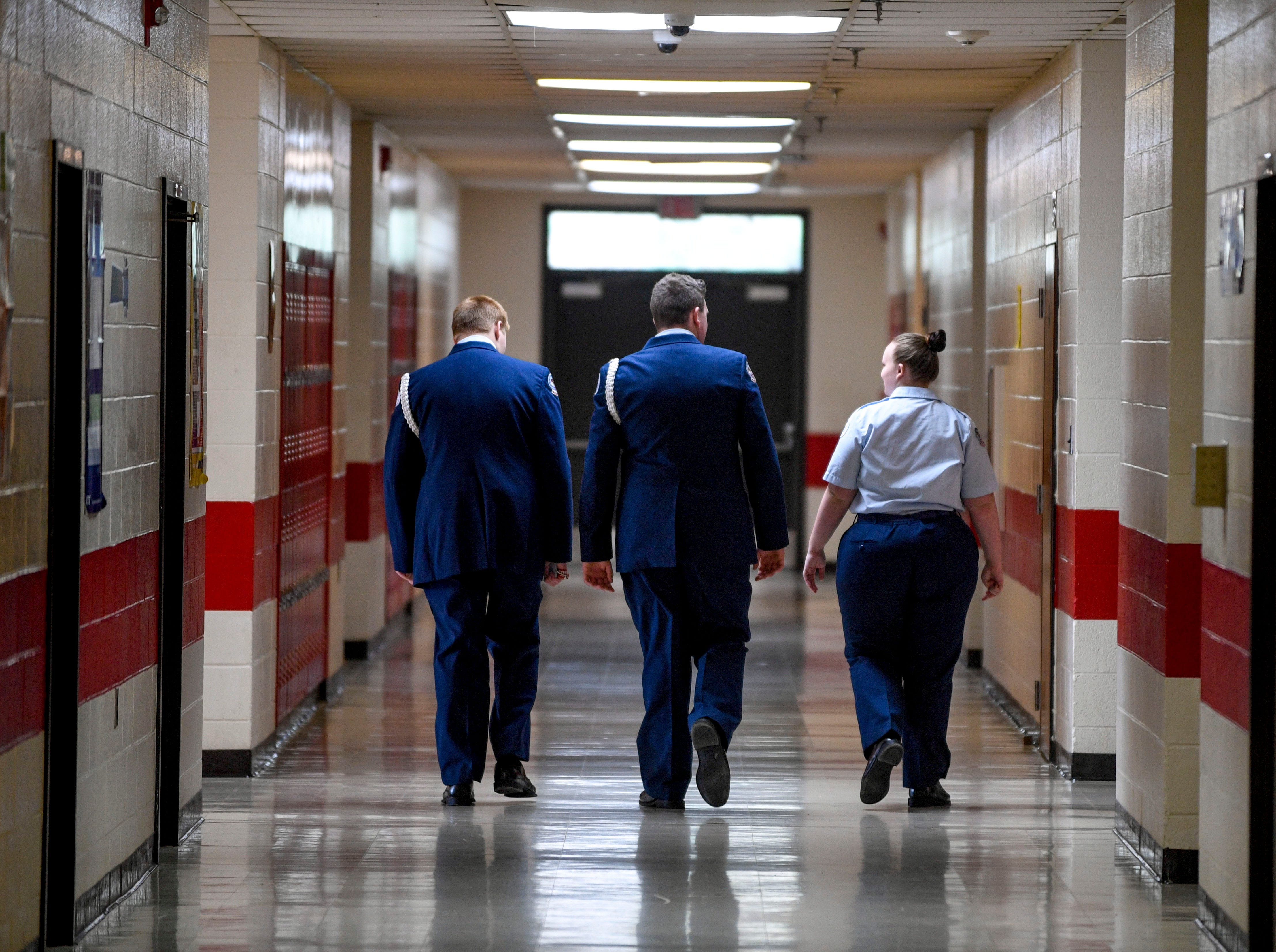 Adam Reeves, 16, left, Kaleb Bull, 17, center, and Allie McGill, 15, right,  return to class after stepping out of class to chat with Army recruiters during ROTC class at Lexington High School in Lexington, Tenn., on Wednesday, Feb. 6, 2019.