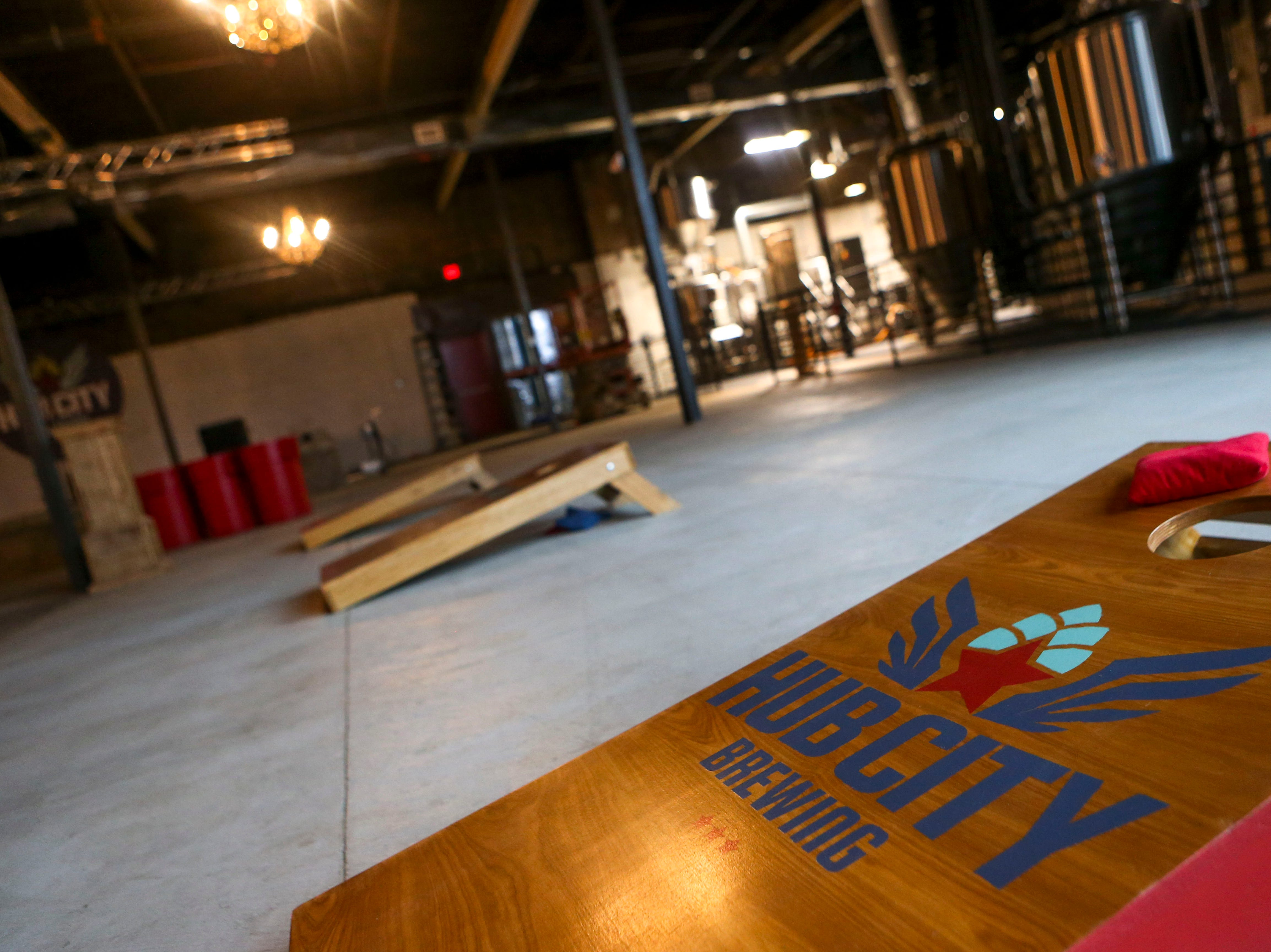 Multiple corn hole stations dot the portion of the brewery that can be used as a concert venue or event area at Hub City Brewing in Jackson, Tenn., on Wednesday, Feb. 6, 2019.