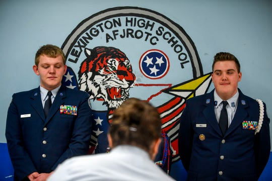 Kaleb Bull, 17, a sophomore, right, looks to his ROTC classmates during a uniform inspection in a ROTC class at Lexington High School in Lexington, Tenn., on Wednesday, Feb. 6, 2019.