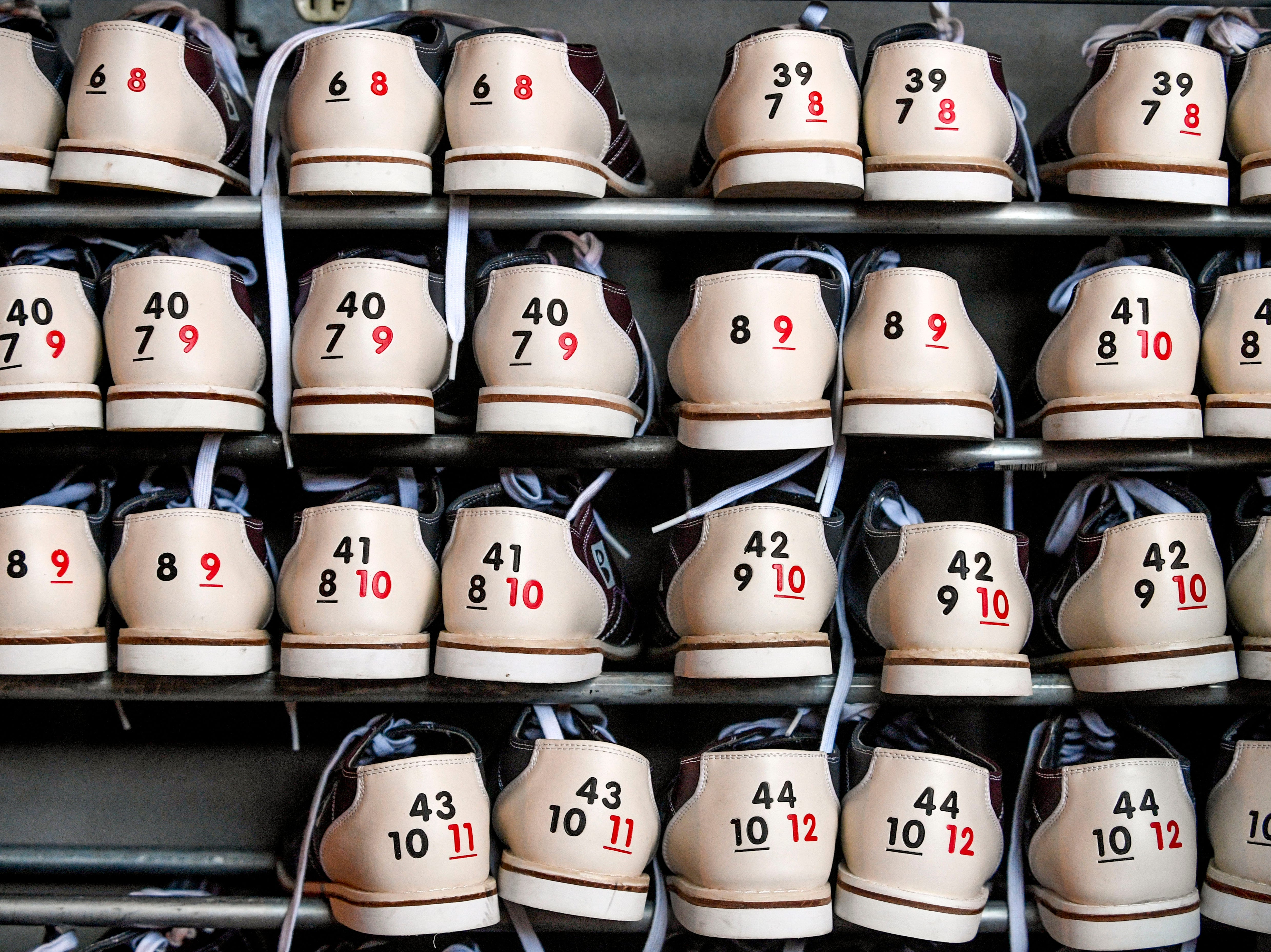 Various sizes of bowling shoes can be seen in cubbies behind the bar at Hub City Brewing in Jackson, Tenn., on Wednesday, Feb. 6, 2019.