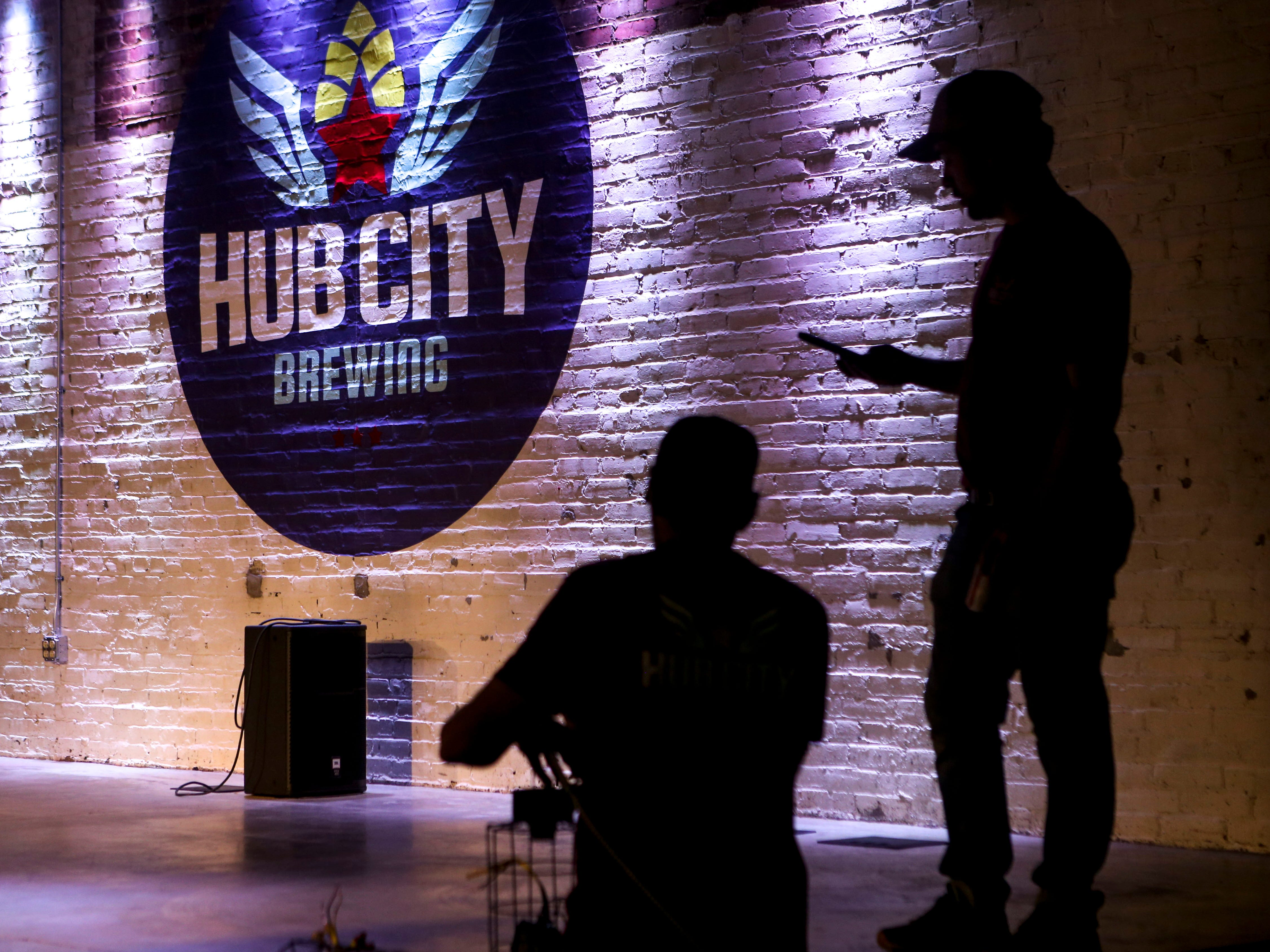 Pat Keith, a Delta Electric electrical technician, left, and Lewis Silvers with Hub City, right, test out the lights to be used on the stage at Hub City Brewing in Jackson, Tenn., on Wednesday, Feb. 6, 2019.