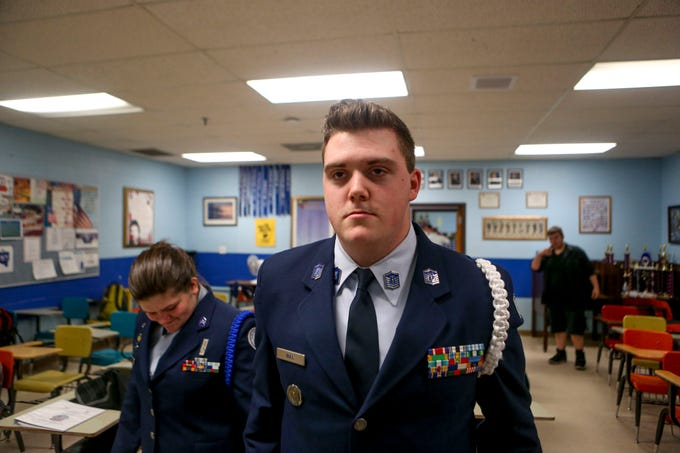 Kaleb Bull, 17, a sophomore, stands at attention while his uniform is inspected by Kendalynn Henley, 16, a junior, during ROTC class at Lexington High School in Lexington, Tenn., on Wednesday, Feb. 6, 2019.