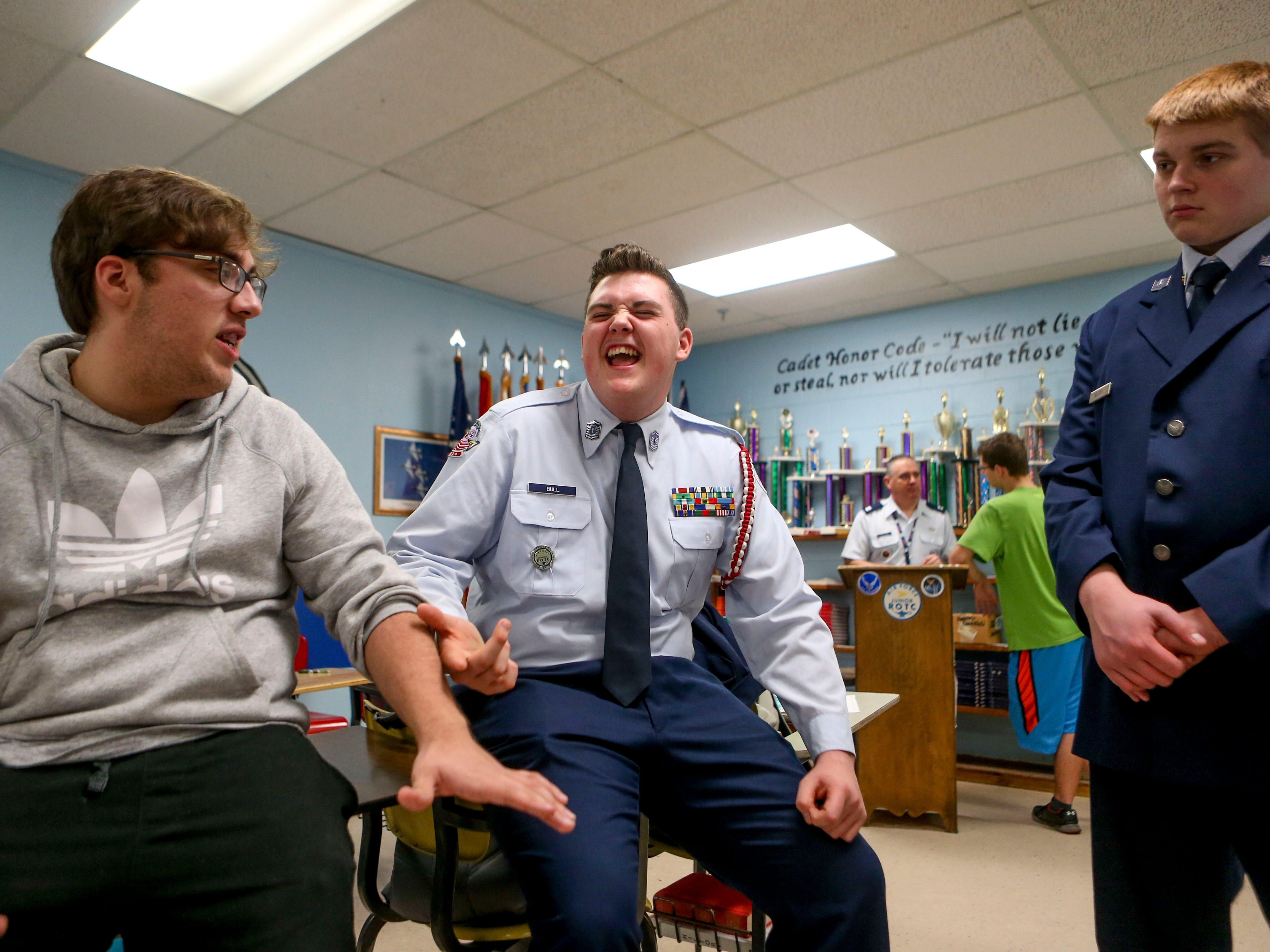 Trevor Woods, 17, left, a senior, and Kaleb Bull, 17, center, a sophomore, joke around during ROTC class at Lexington High School in Lexington, Tenn., on Wednesday, Feb. 6, 2019.