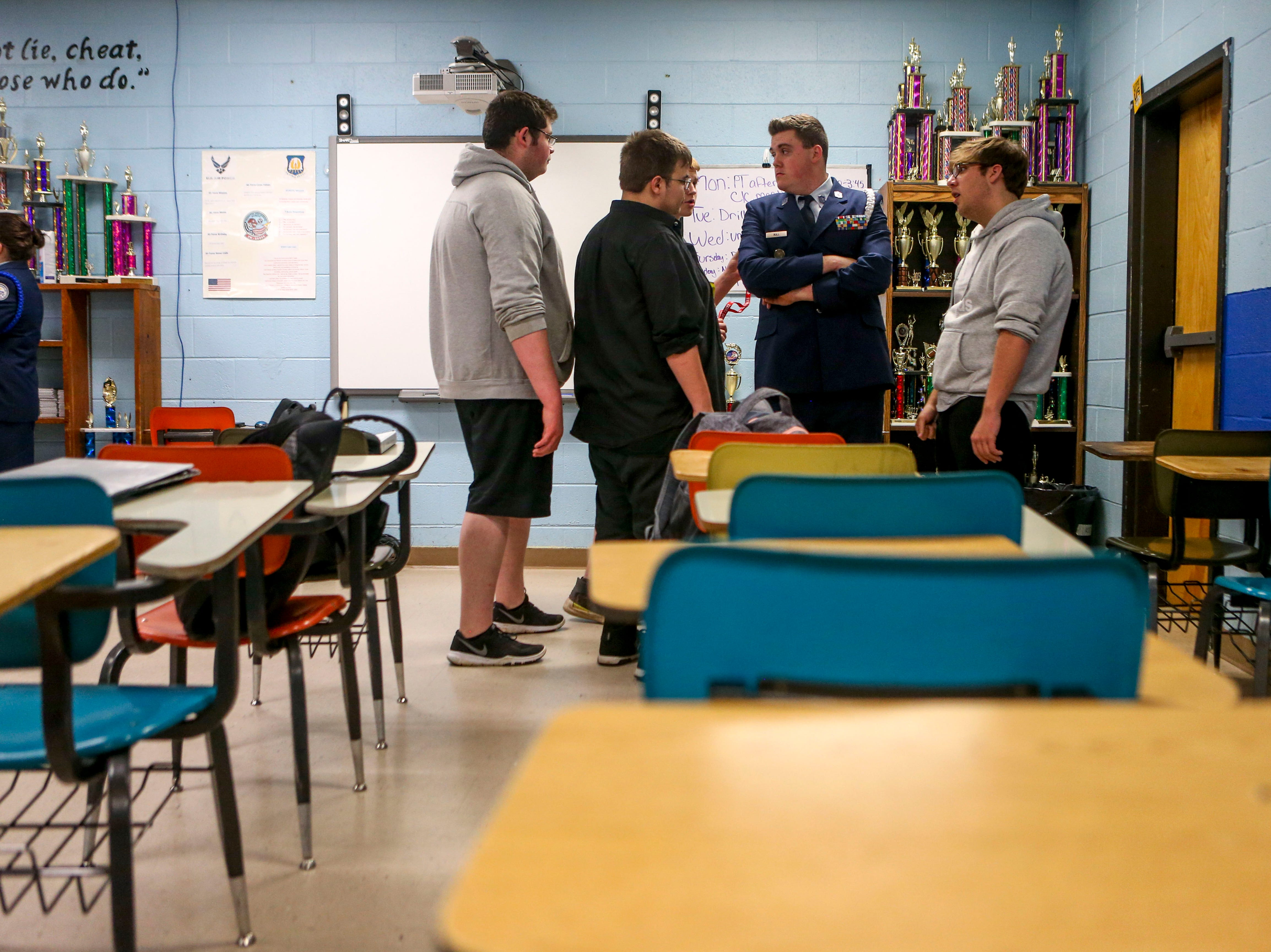 ROTC students stand around and chat during ROTC class at Lexington High School in Lexington, Tenn., on Wednesday, Feb. 6, 2019.