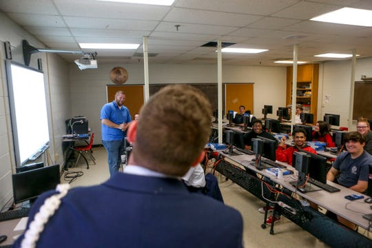Another teacher brings Kaleb Bull, 17, a sophomore, into the classroom to ask him a question during ROTC class at Lexington High School in Lexington, Tenn., on Wednesday, Feb. 6, 2019.