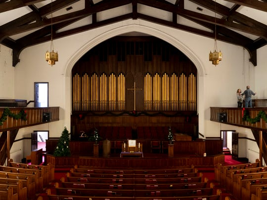 Magnolia Avenue United Methodist Church has a two-story sanctuary with a wrap-around balcony, still-working pipe organ and large stained-glass windows.
