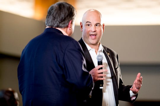 Tennessee Head Coach Jeremy Pruitt speaks on stage with Bob Kesling, Director of Broadcasting, during a Tennessee signing day celebration at the UTK Student Union in Knoxville, Tennessee on Wednesday, February 6, 2019.