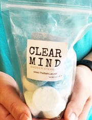 "The ""Clear Mind"" disc sized shower steamers are a mix of eucalyptus, menthol and peppermint and release their fragrance when the water hits them."
