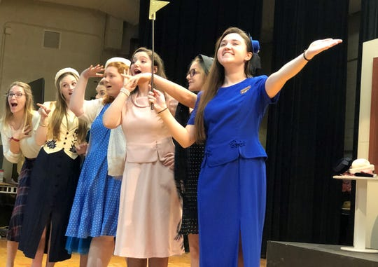 : A New York City tour guide (Katelynn Mundt) welcomes everyone to the big city in a dress rehearsal for Guys and Dolls at Gibbs High School.