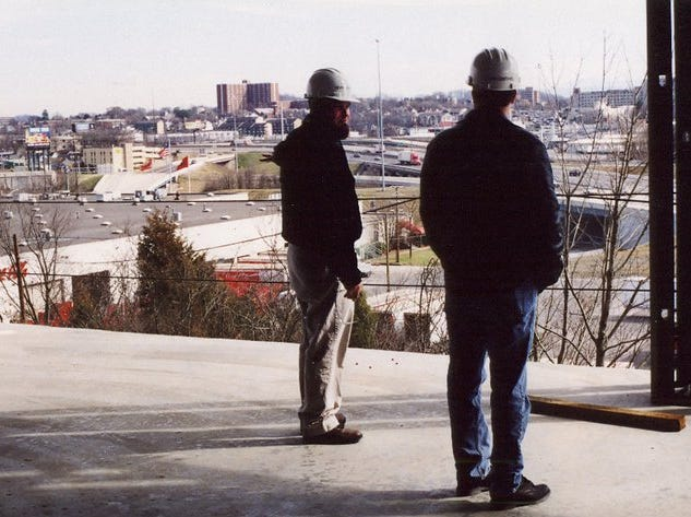 Chuck Campbell, left, and Rusty Pabst take in the view from the unfinished News Sentinel building off Western Avenue, February, 2002, Knoxville, Tenn.
