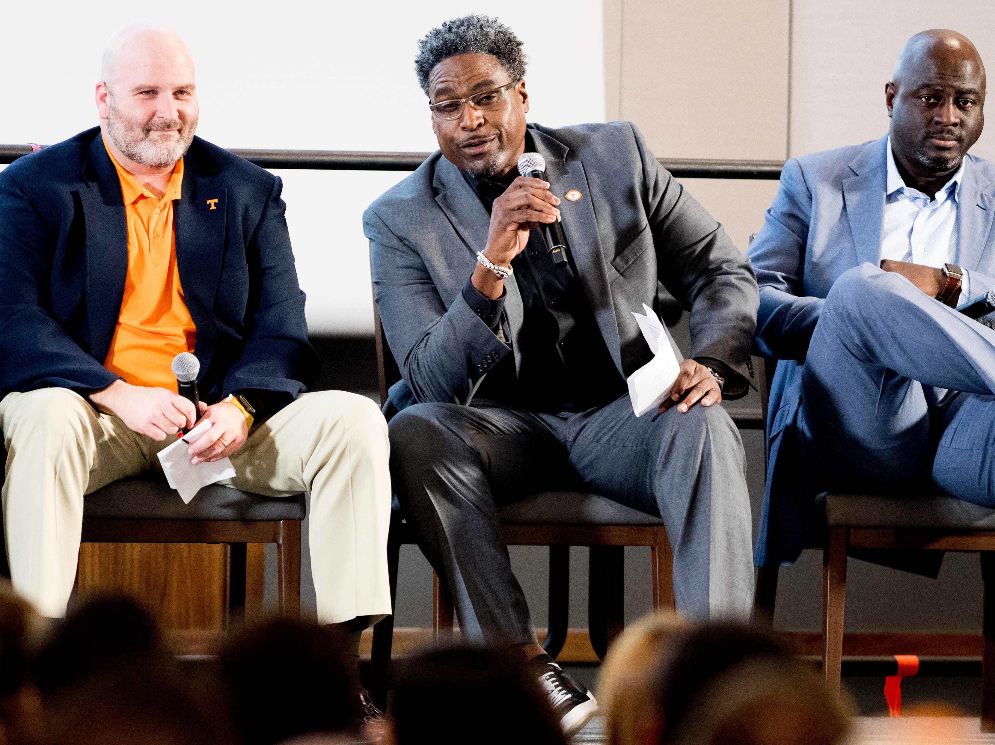 Defensive line coach Tracy Rocker speaks beside offensive line coach Will Friend, left, and Co-Defensive Coordinator / Outside Linebackers Chris Rumph, right, during a Tennessee signing day celebration at the UTK Student Union in Knoxville, Tennessee on Wednesday, February 6, 2019.