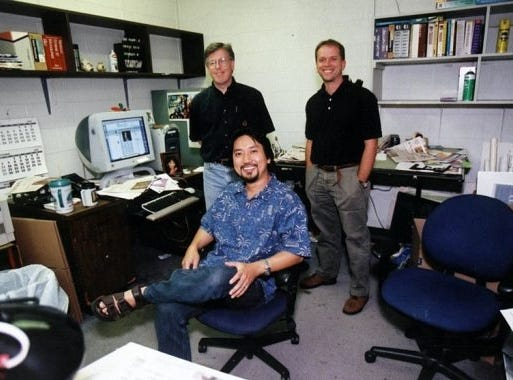 The Knoxville News Sentinel Art Department - Rey Pineda, Dan Proctor, Don Wood. Photo taken at 208 W. Church Ave., Knoxville, Tenn., August 2002.