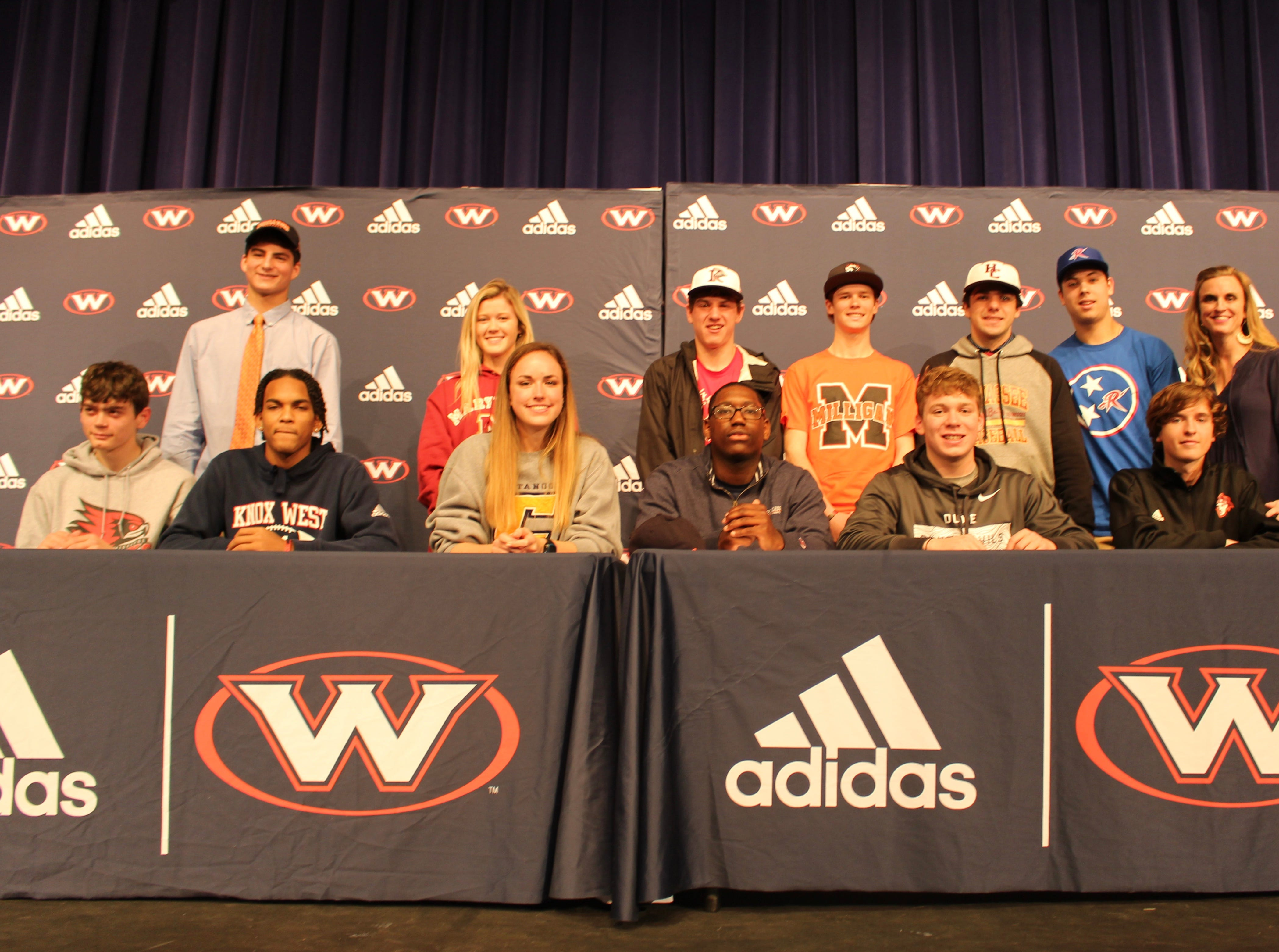 A dozen athletes from West High School signed with a college on National Signing Day 2019. Pictured are: (front) Shea DeGraaf,  track at Southeast Missouri State; Cedarius Bost, football for Georgetown College;  Anne Katherine Anderson, soccer for the University of Tennessee at Chattanooga; Demarcus Nelson,  football for Carson-Newman University; Coleman Kredich,  swimming at Duke University; Carter McAdoo, soccer at Maryville College; (back) Will Eggleston, football at Wheaton College; Bailey Ensley, softball at Maryville College; Jake Wilkinson, baseball with King College; Hunter Connell, cycling for Milligan College; Joey Miller, baseball for Hiwassee College; Brandon Langenberg, baseball for Roane State Community College; and principal Ashley Jessie.