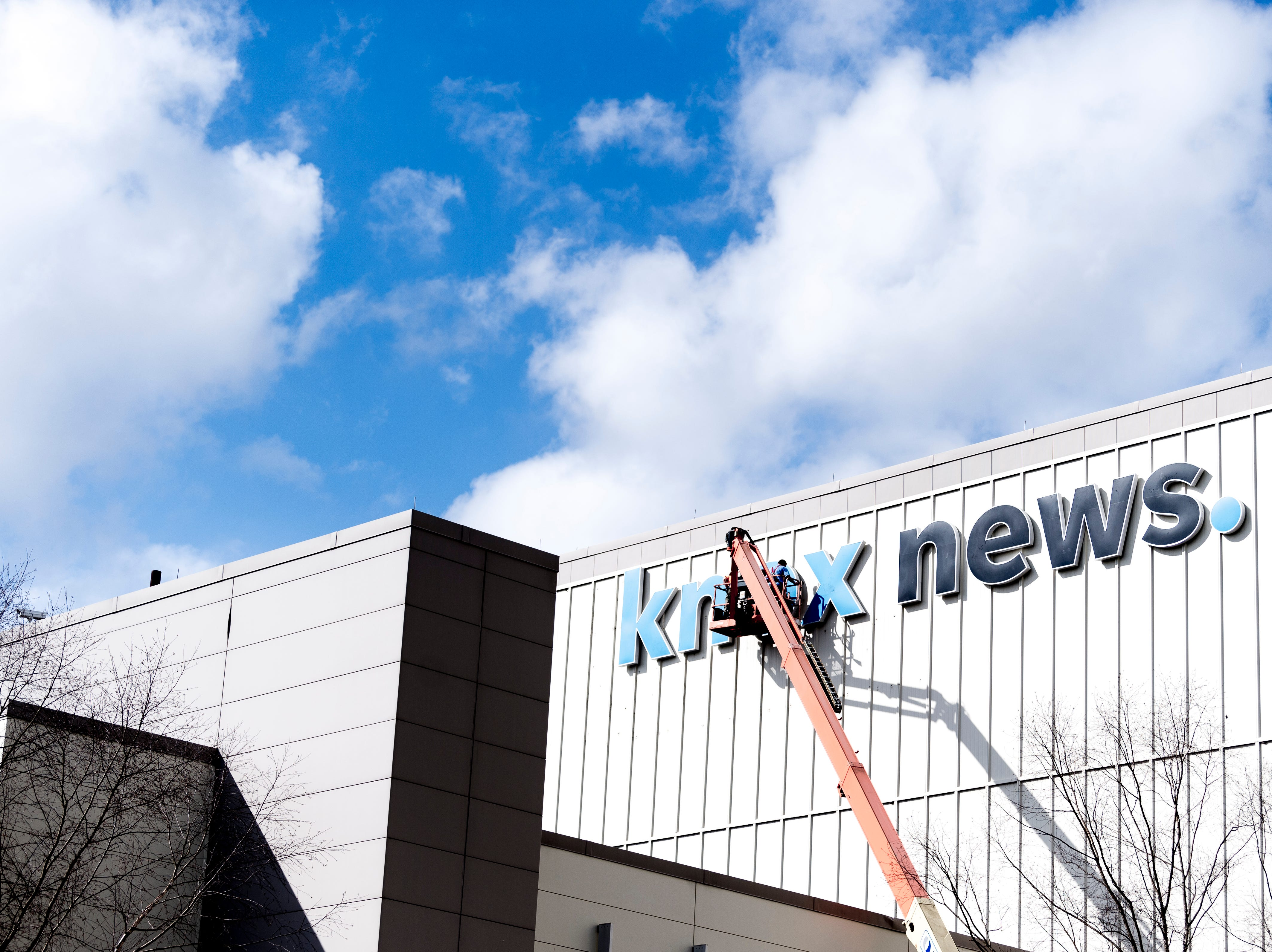 """Workers from Sycamore Sign Service install the """"knox news."""" sign on the front of the Knoxville News Sentinel building on 2332 News Sentinel Dr. in Knoxville, Tennessee on Thursday, February 7, 2019."""