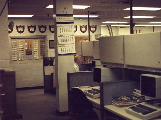 The Knoxville News Sentinel newsroom at 208 W. Church Ave., Knoxville, Tenn., 1994. That's long-time writer Carson Brewer at the Atex terminal.