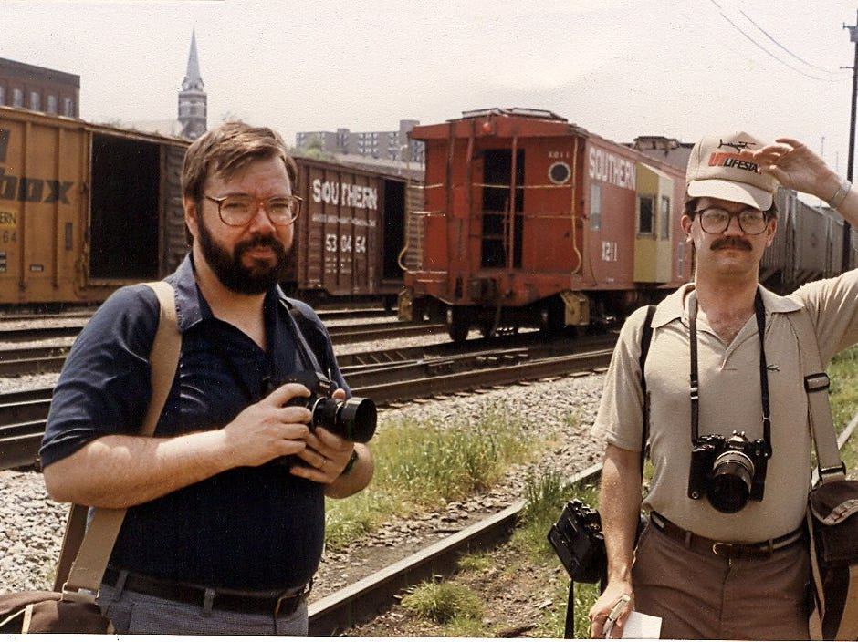 News Sentinel photo director Bob Donaldson, left, and photographer Frank Breithaupt await a steam train in the Norfolk Southern yard in downtown Knoxville, Tenn., April, 1985.