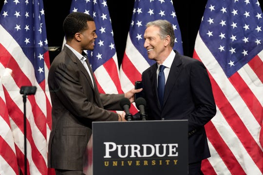 Howard Schultz, right, former Starbucks CEO, is greeted by Aaron Banks, Purdue's student body president, Thursday in Fowler Hall in Purdue's Stewart Center. Schultz was at Purdue to talk about his potential bid to run for president in 2020 as an independent.