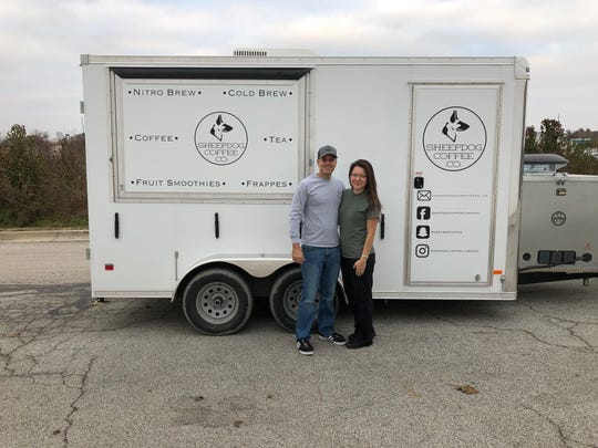Nathan and Sarah Biddle stand outside of their fully converted trailer for Sheepdog Coffee Company, officially licensed to serve in the Tippecanoe County area.