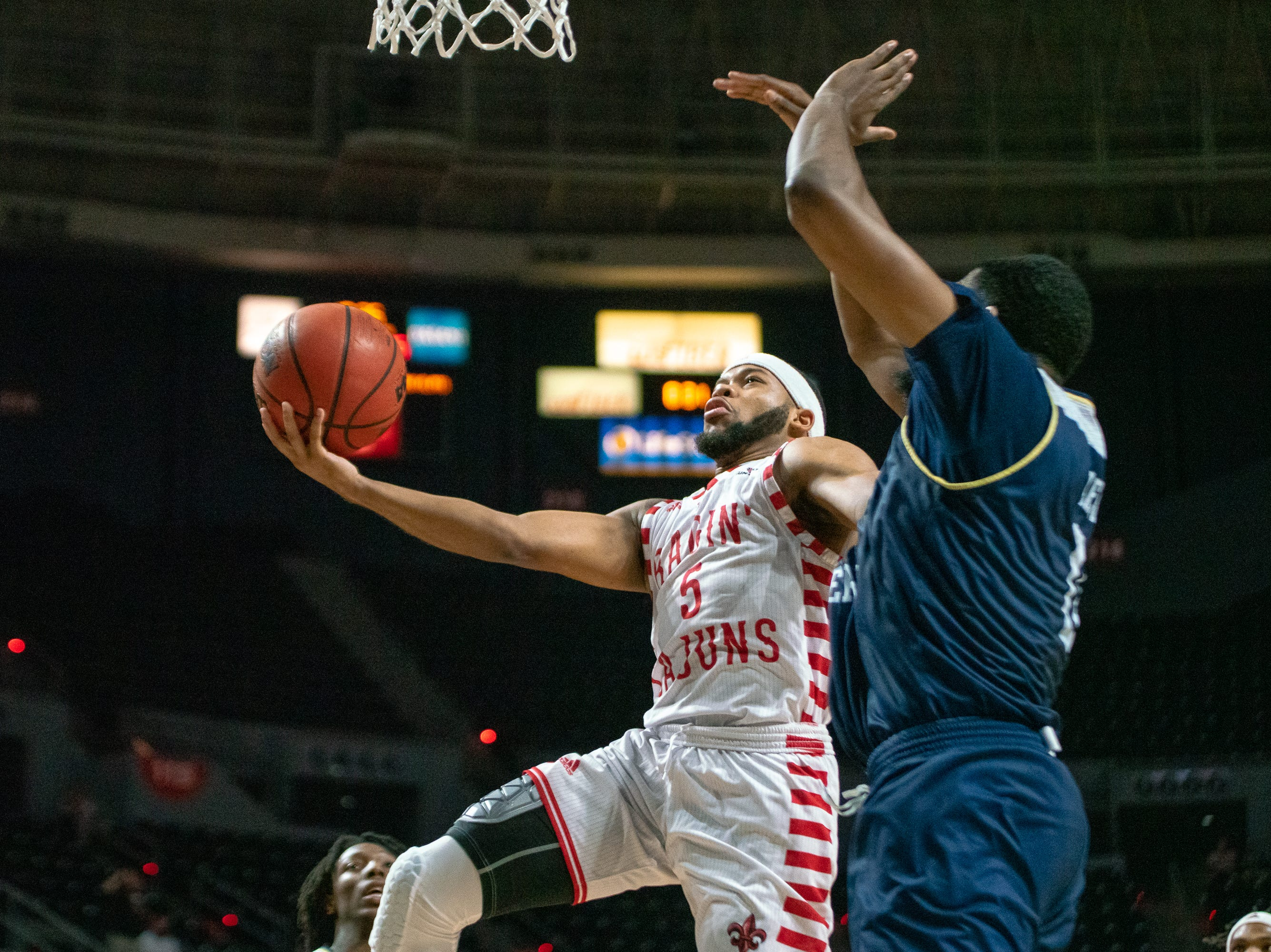 UL's Trajan Wesley takes the ball to the basket as the Ragin' Cajuns take on the Georgia Southern Eagles at the Cajundome on Feb. 6, 2019.