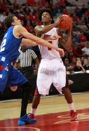 Georgia State's R.J. Hunter (left) and UL's Elfrid Payton (right), both now pro players, go at it during a 2014 game at the Cajundome that helped ignite a rivalry between the Panthers and the Ragin' Cajuns.